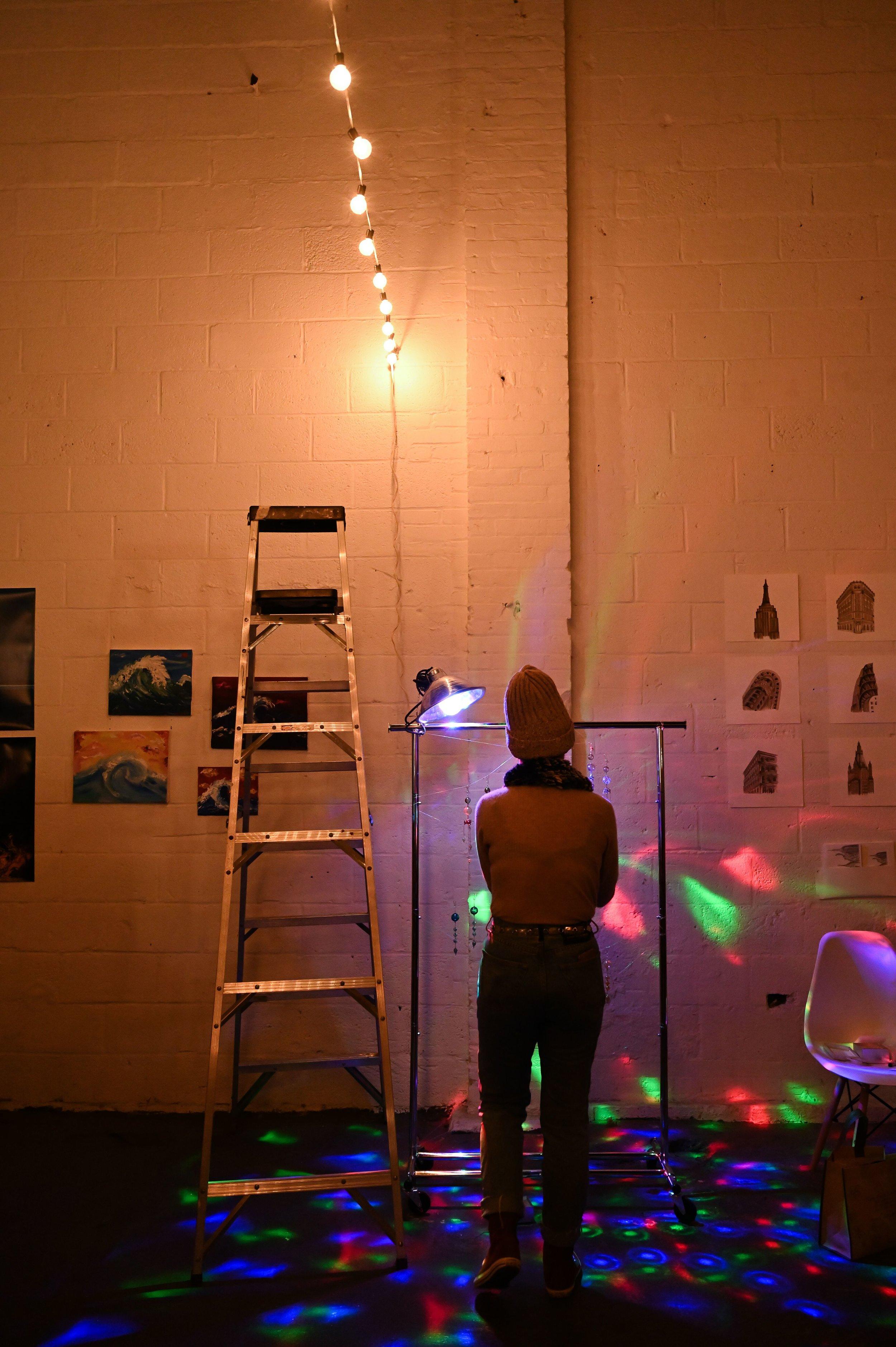 Artist  Goldie De La Roca  setting up her piece at The Canvas.