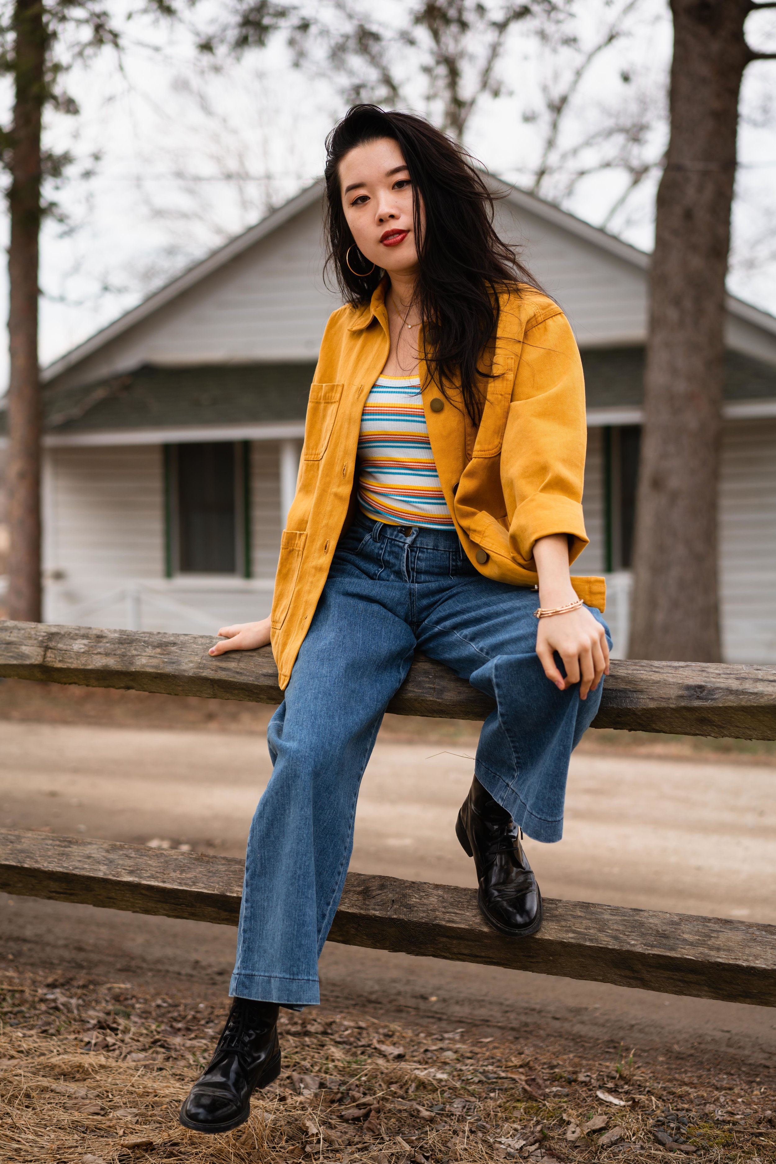 Fashion Editor,  Julia Le , wearing a  BackBeatRags  utility jacket, layered with a  Liana  tank top and  Loup  jeans. Secondhand jewelry, thrifted boots.