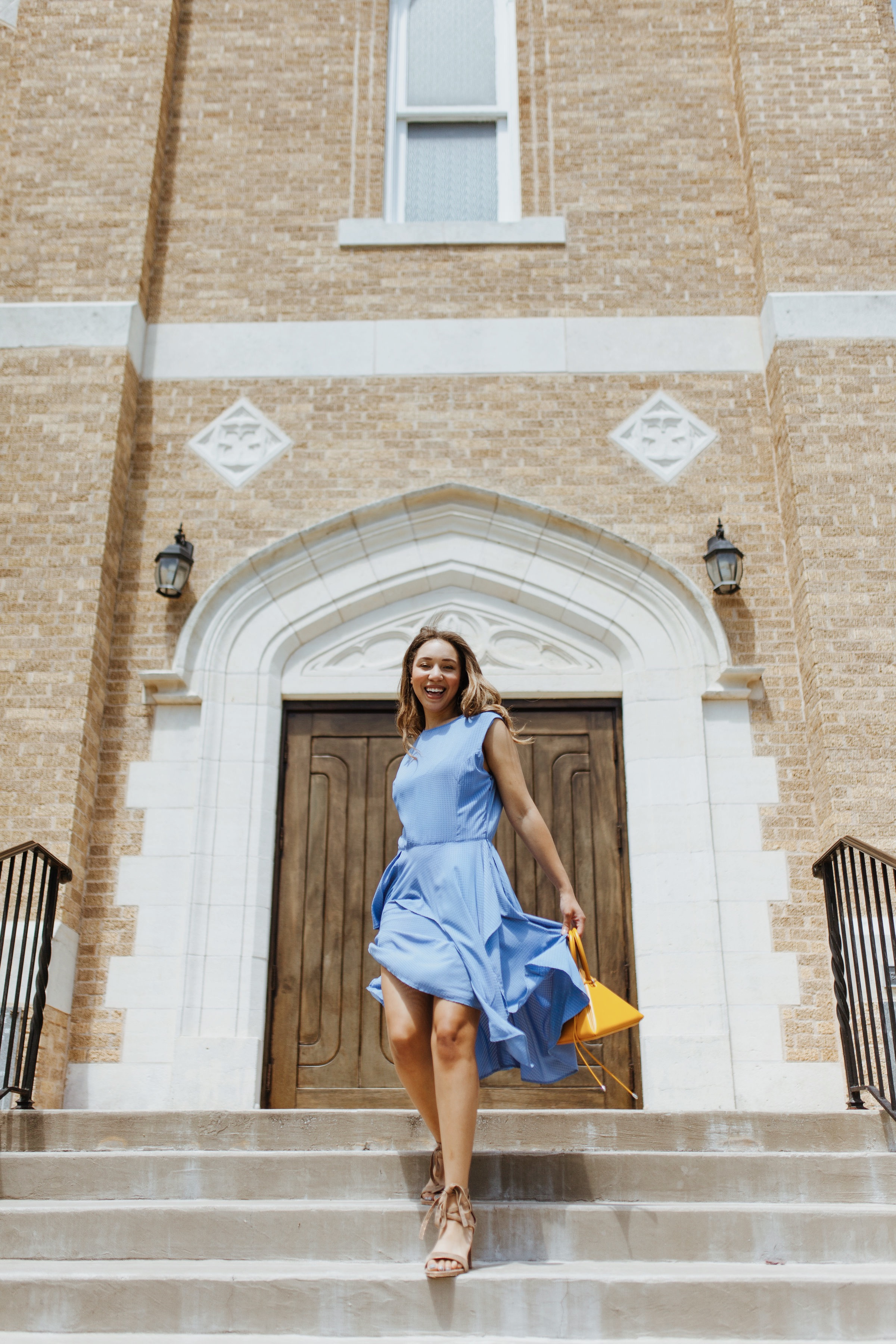 Photographed in front of Wesley United Methodist Church, which was established at the end of the Civil War for freed people in the East Austin area on March 4, 1865 . Ana, wearing a blue silk dress by  Nina Means .