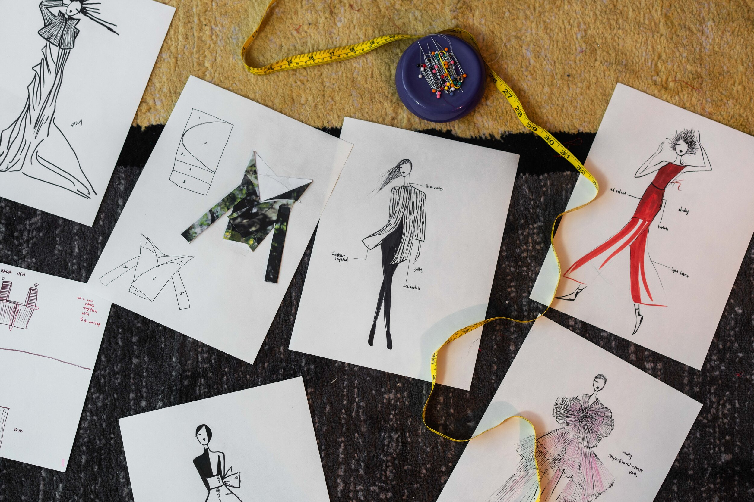 A series of Xu's sketches, including original designs and inspiration, as well as some of the patterns and paper-folding technique she uses in planning her designs.