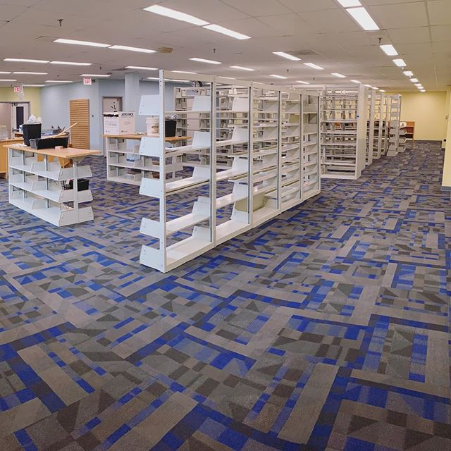 Another day, another library project complete! 📚 Yesterday our crew completed a library at a local college using @shawcontract carpet tiles, and wow - what a fun style they selected! We love the look of this space and hope the students do as well! 😁