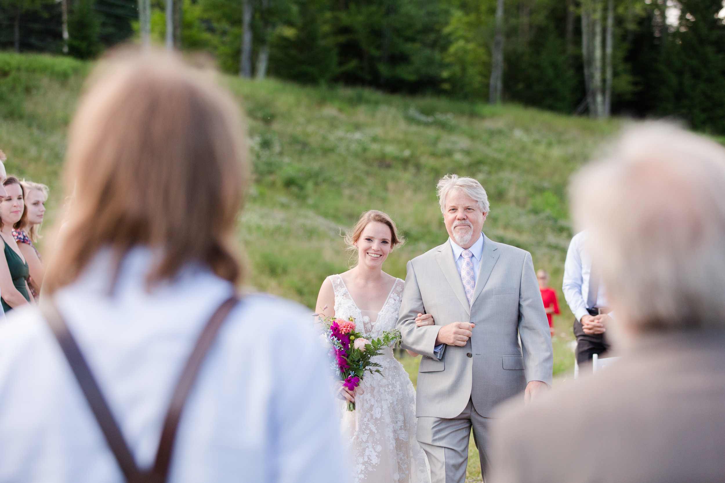 authentic genuine wedding photography in wv - bride escorted by father down aisle, lakeside mountain wedding wv