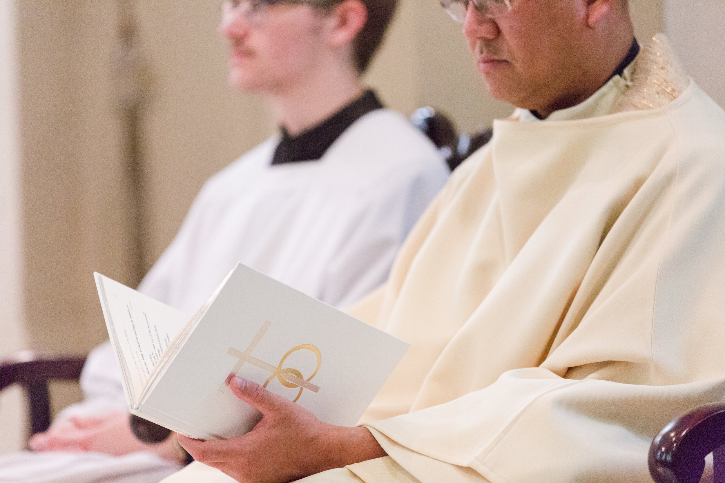 Rite of Marriage Book in Priest's hands