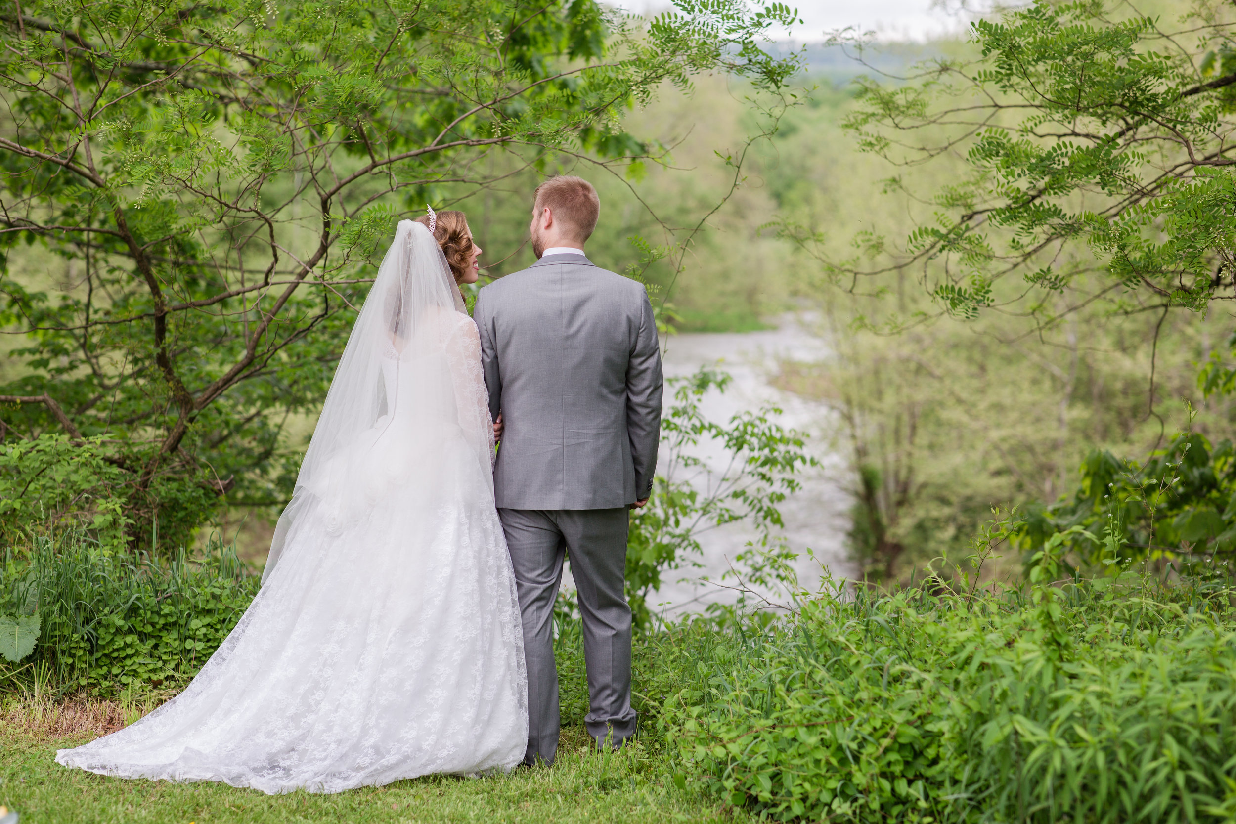 wedding couple overlooking cliff and river