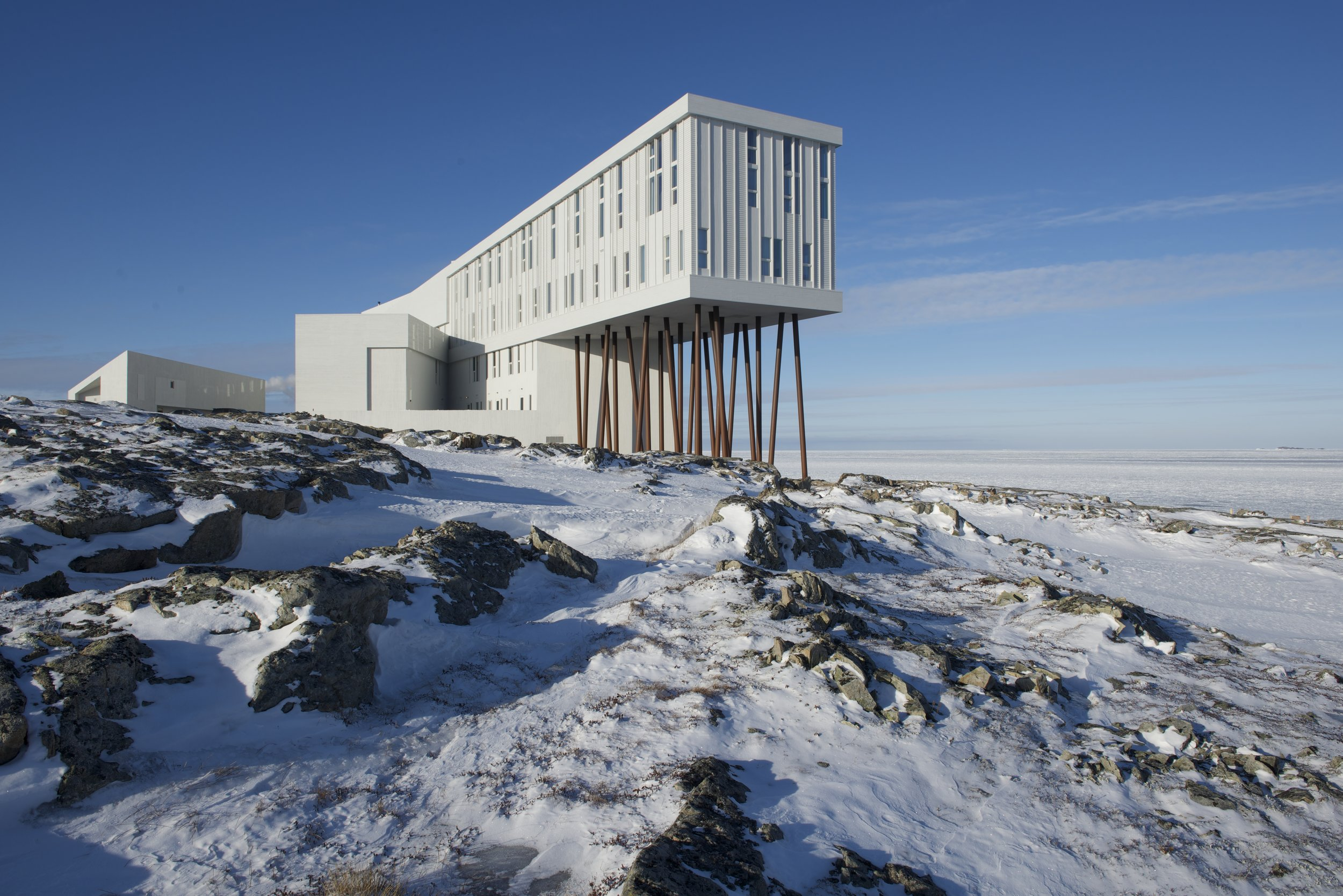 The exterior of Fogo Island Inn is like a glimpse into the future, or a scene from another planet.  Photo courtesy of Fogo Island Inn