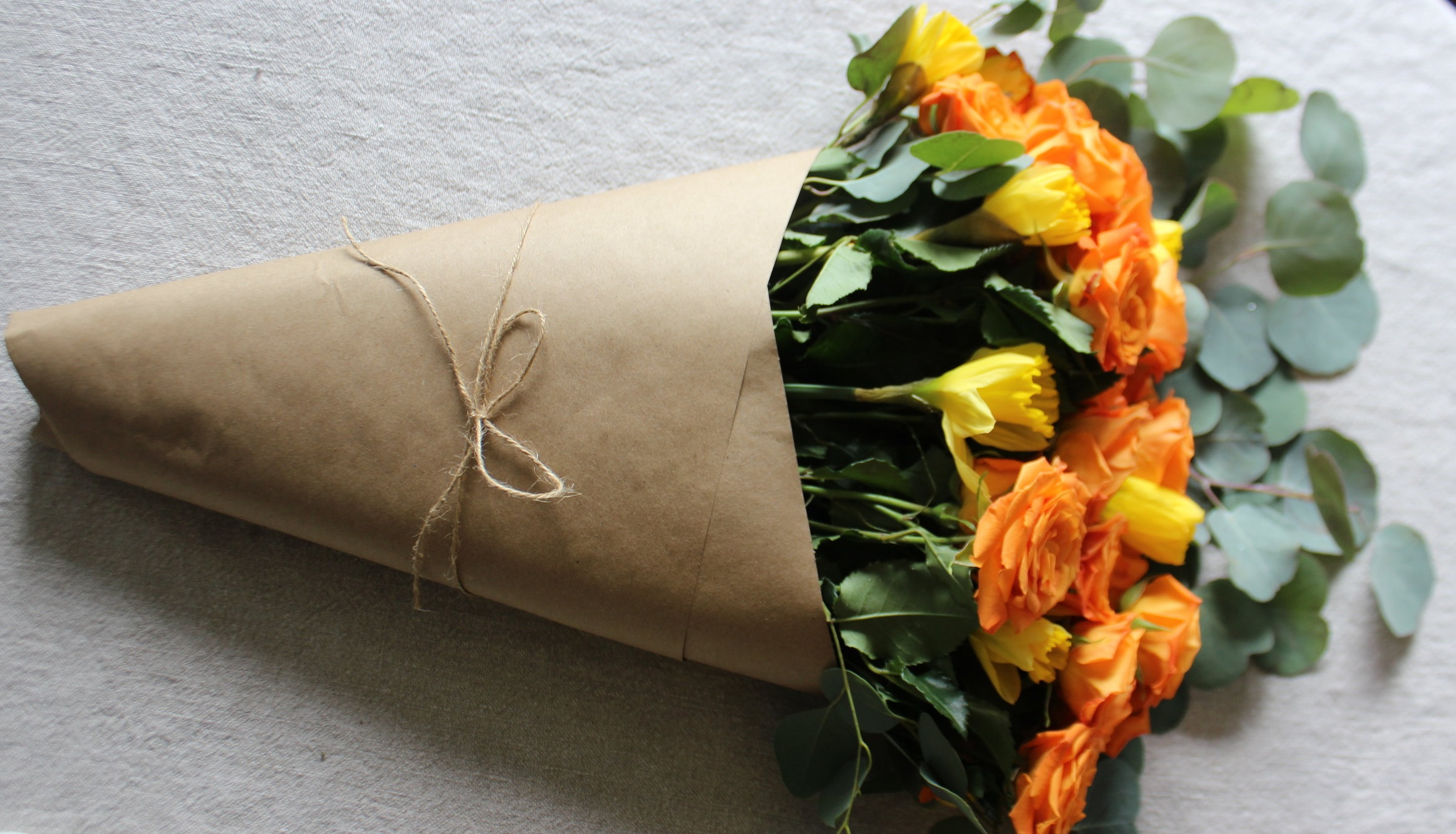 If you're gifting, lose the plastic. Nothing screams grocery store flowers like logo-printed plastic. Instead, wrap with brown kraft paper and tie with twine.