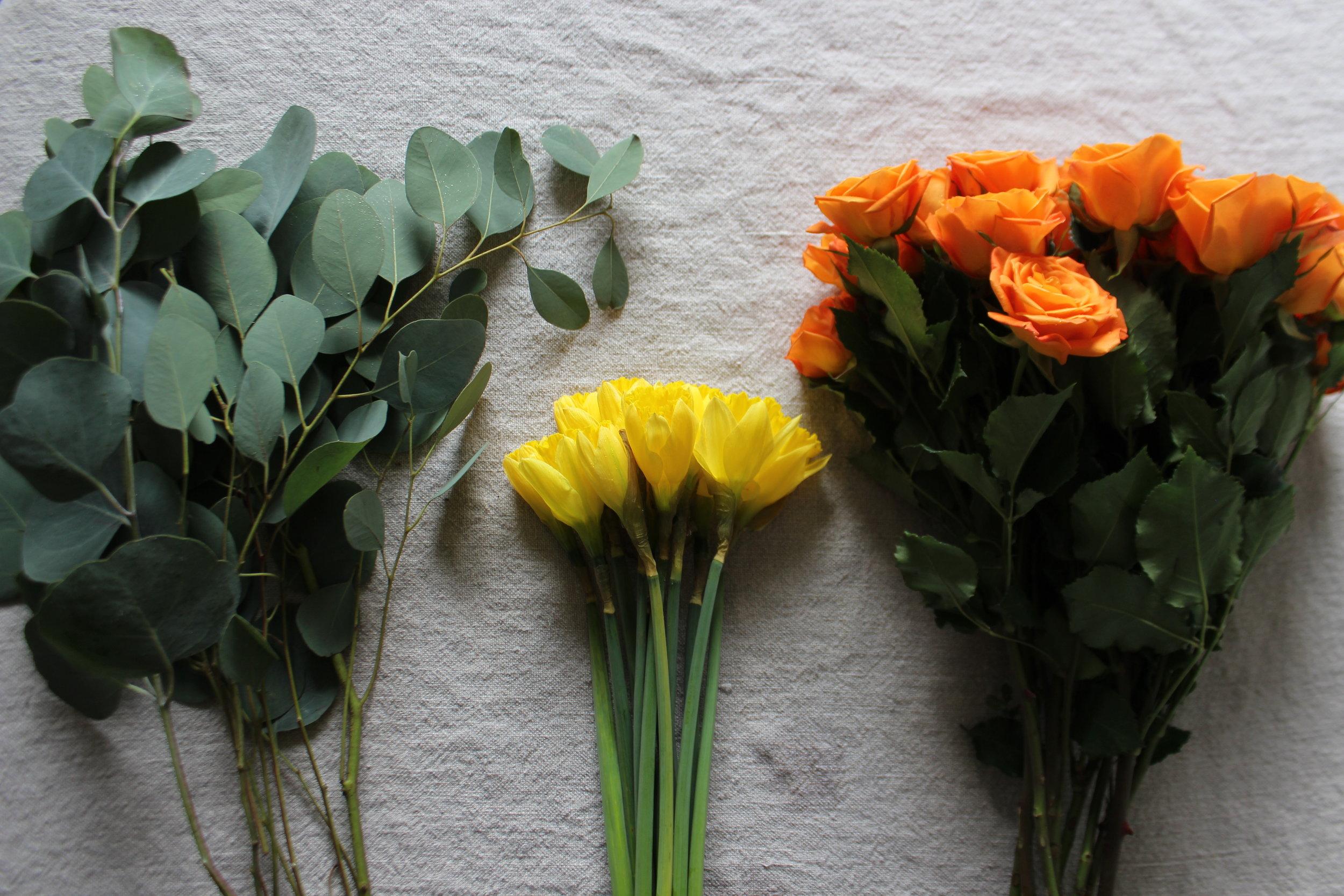 Silver Dollar Eucalyptus: $2.99 a bunch, Daffodils: $1.49 a bunch, Spray Roses: $4.99 a bunch = $9.47 total!