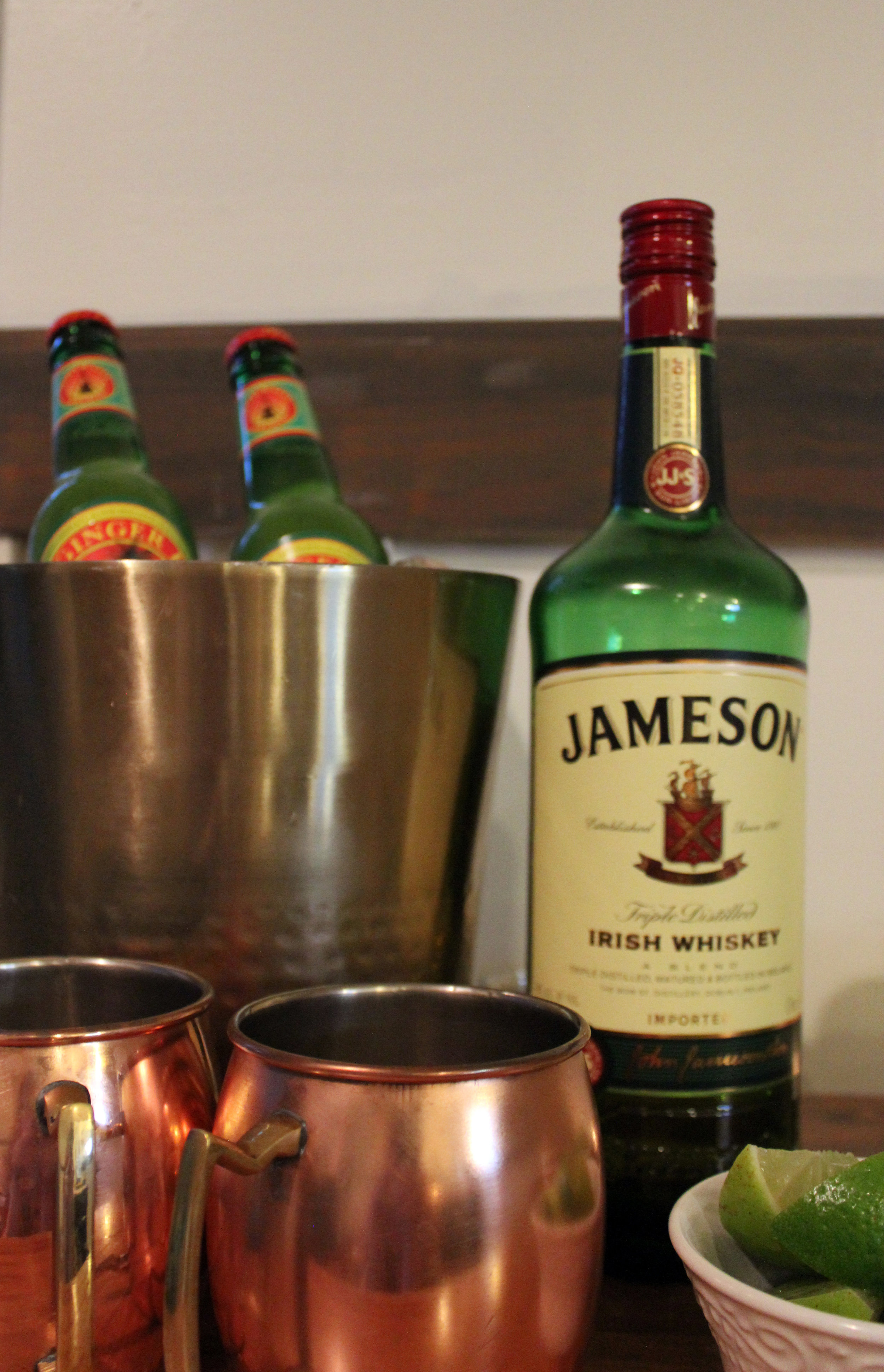 Swap the vodka for Jameson and you've got yourself a Dublin Mule.   4 ounces whiskey    2 ounce freshly squeezed lime juice (~ 2 limes)    8 to 12 ounces of good quality ginger beer    lime wedge (for garnish)