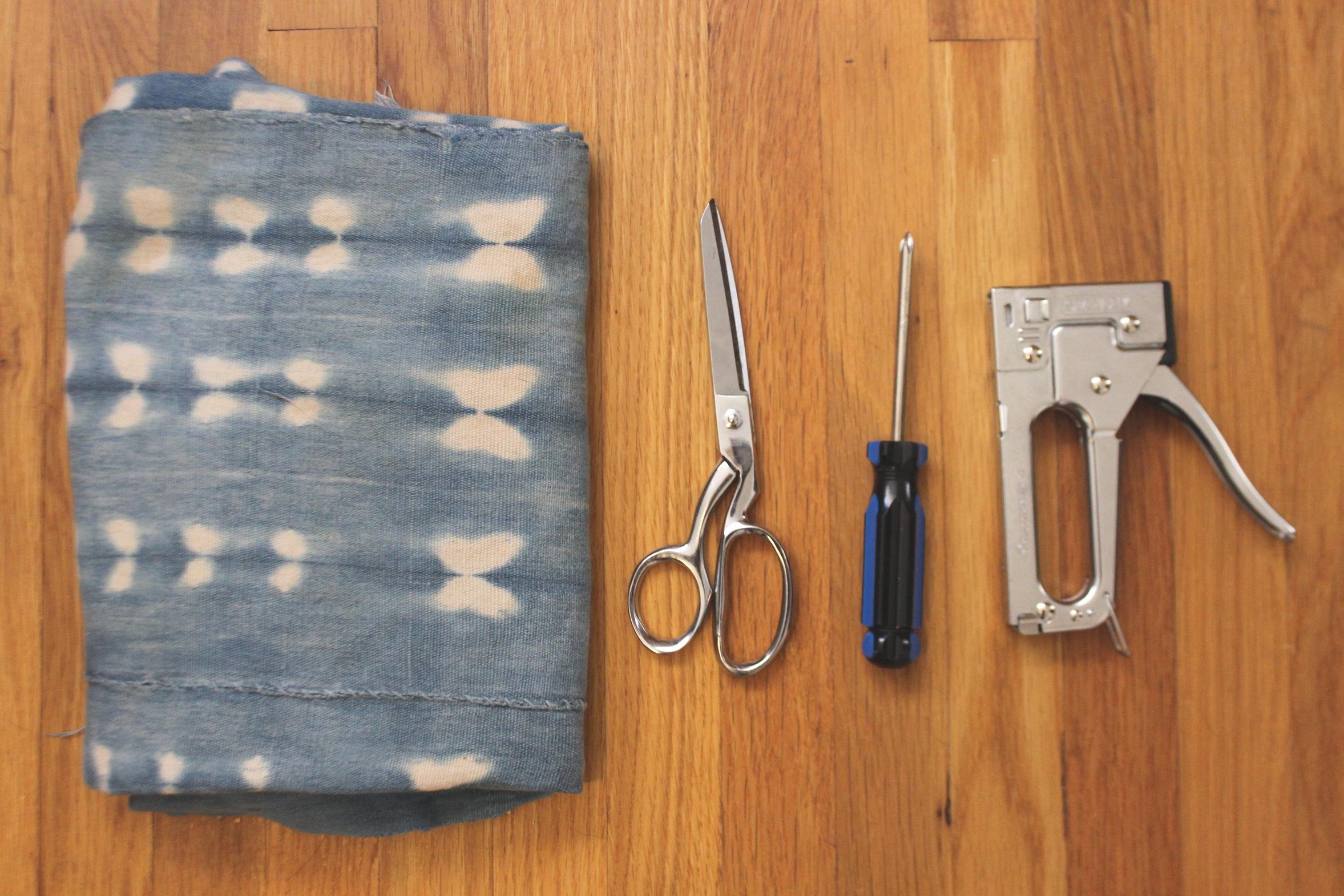 Fabric, fabric scissors, screwdriver, staple gun.  Not pictured: staple gun remover.