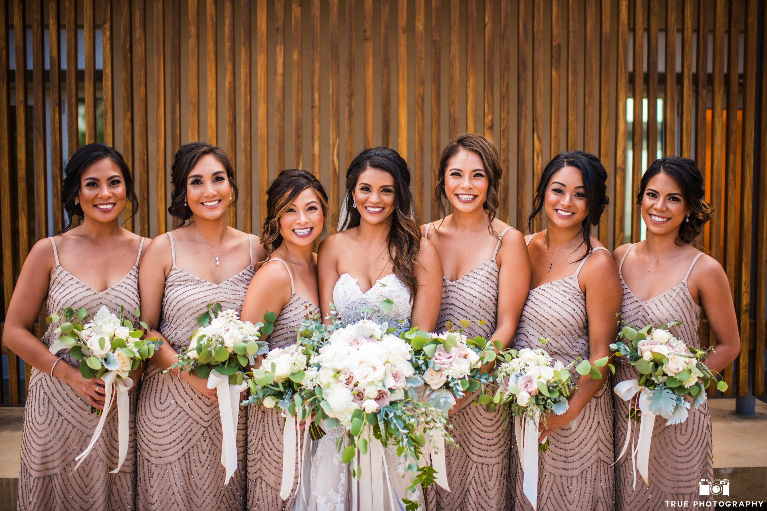 Photography  True Photography ||  Wedding Dress  The White Flower Bridal Boutique ||  Hair  Cara Mia Makeup Artistry & Hair Designs ||  Bridesmaids Dresses  Adrianna Papell || Click  here  for more of this wedding.