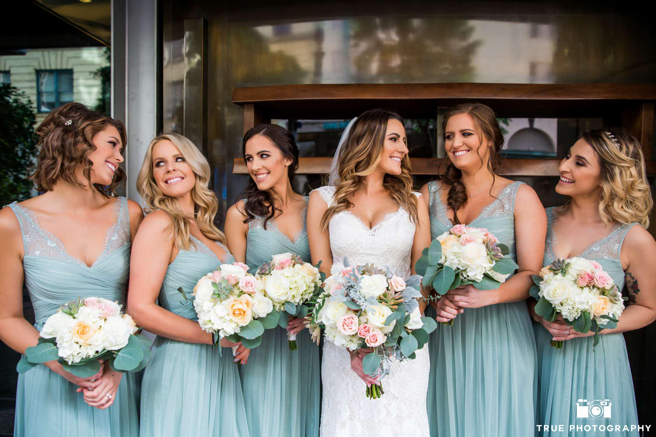 Photography  True Photography ||  Wedding Dress  BHLDN ||  Makeup  Shelby McElroy ||  Hair  Jessica Tyransky Hair & Makeup ||  Bridesmaids Dresses  BHLDN || Click  here  for more of this wedding.