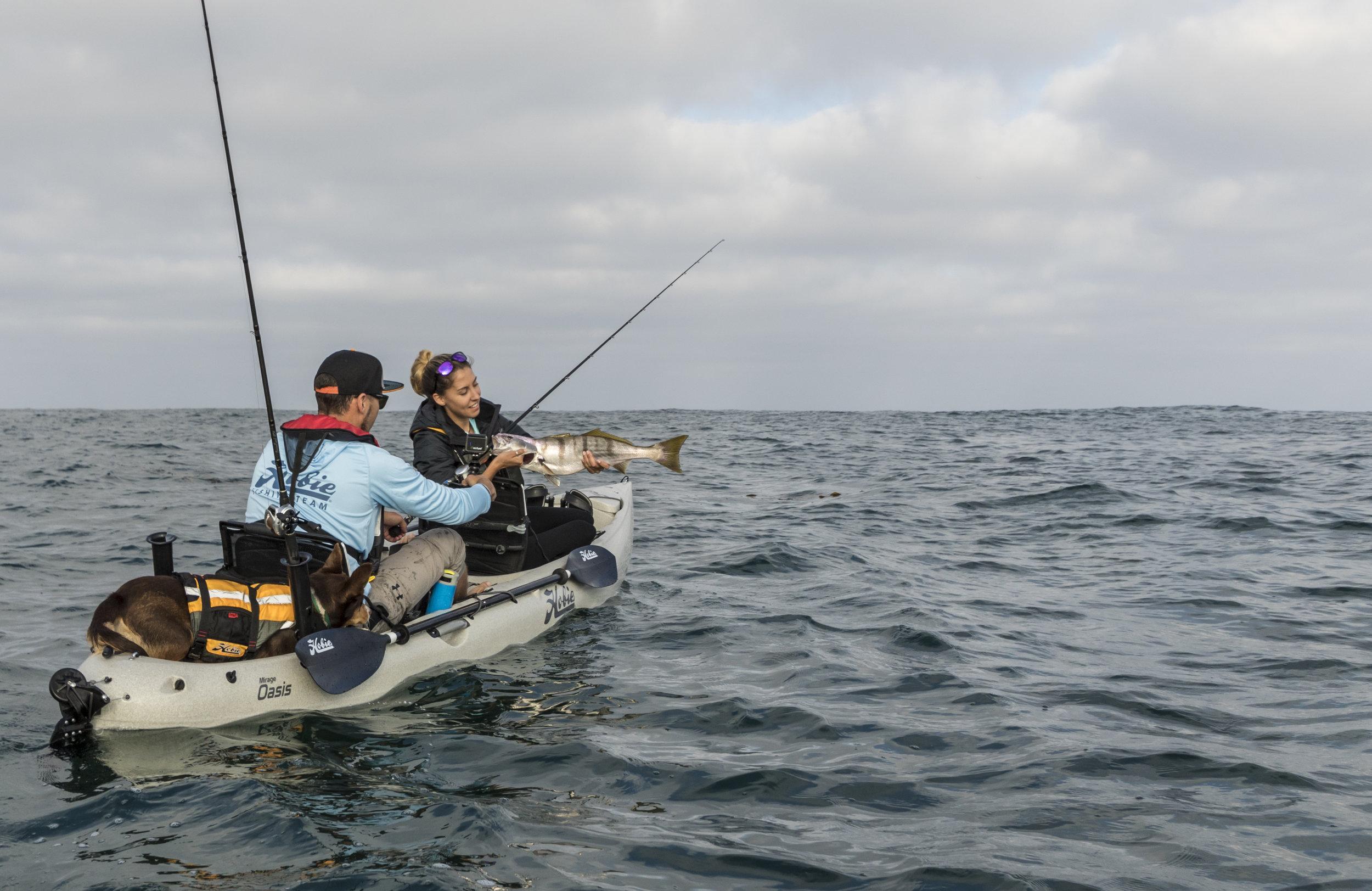 Oasis_action_fishing_dune_seabass_grip_couple_dog.jpg