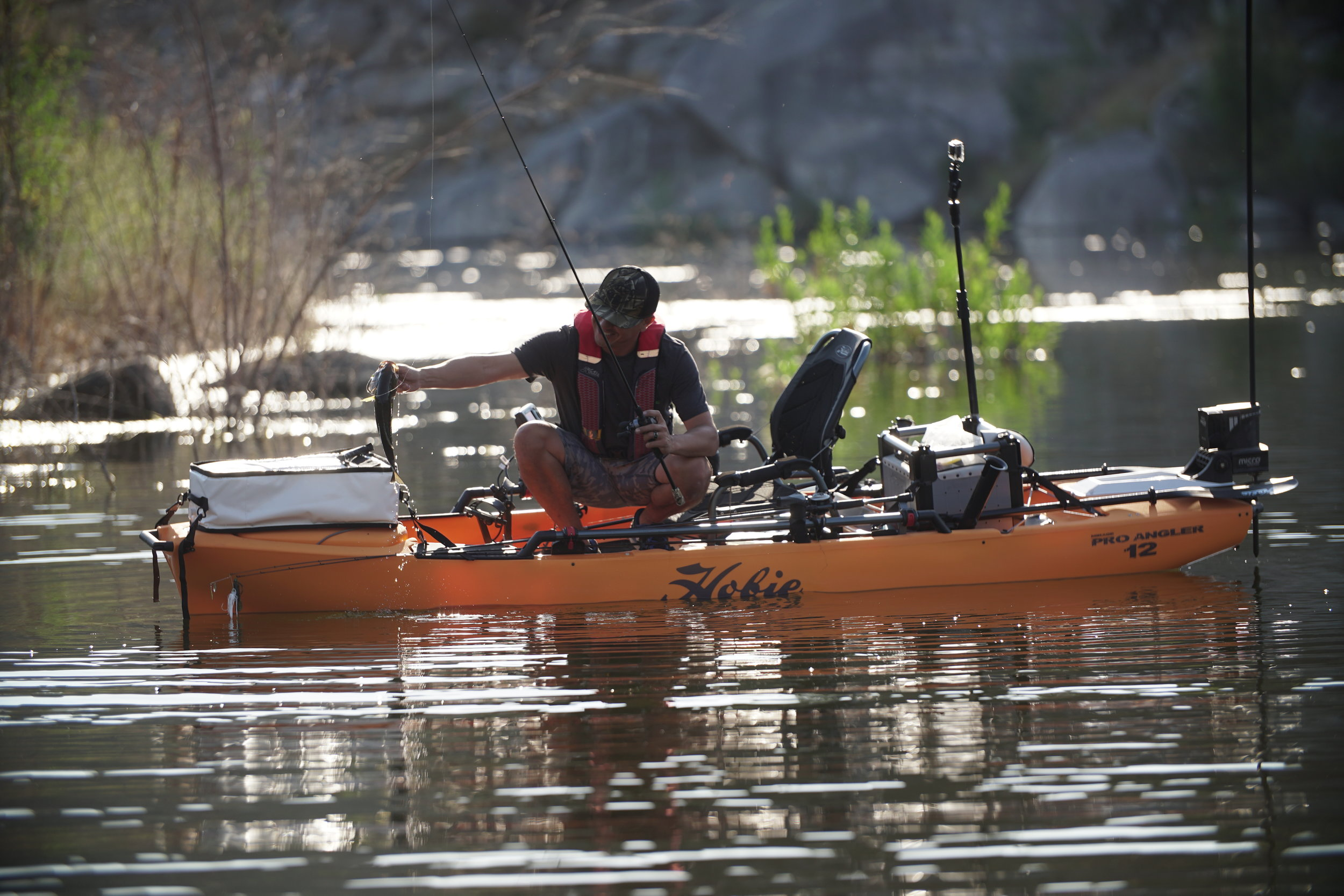 ProAngler12_action_fishing_bass_splash_sunset_papaya.jpg