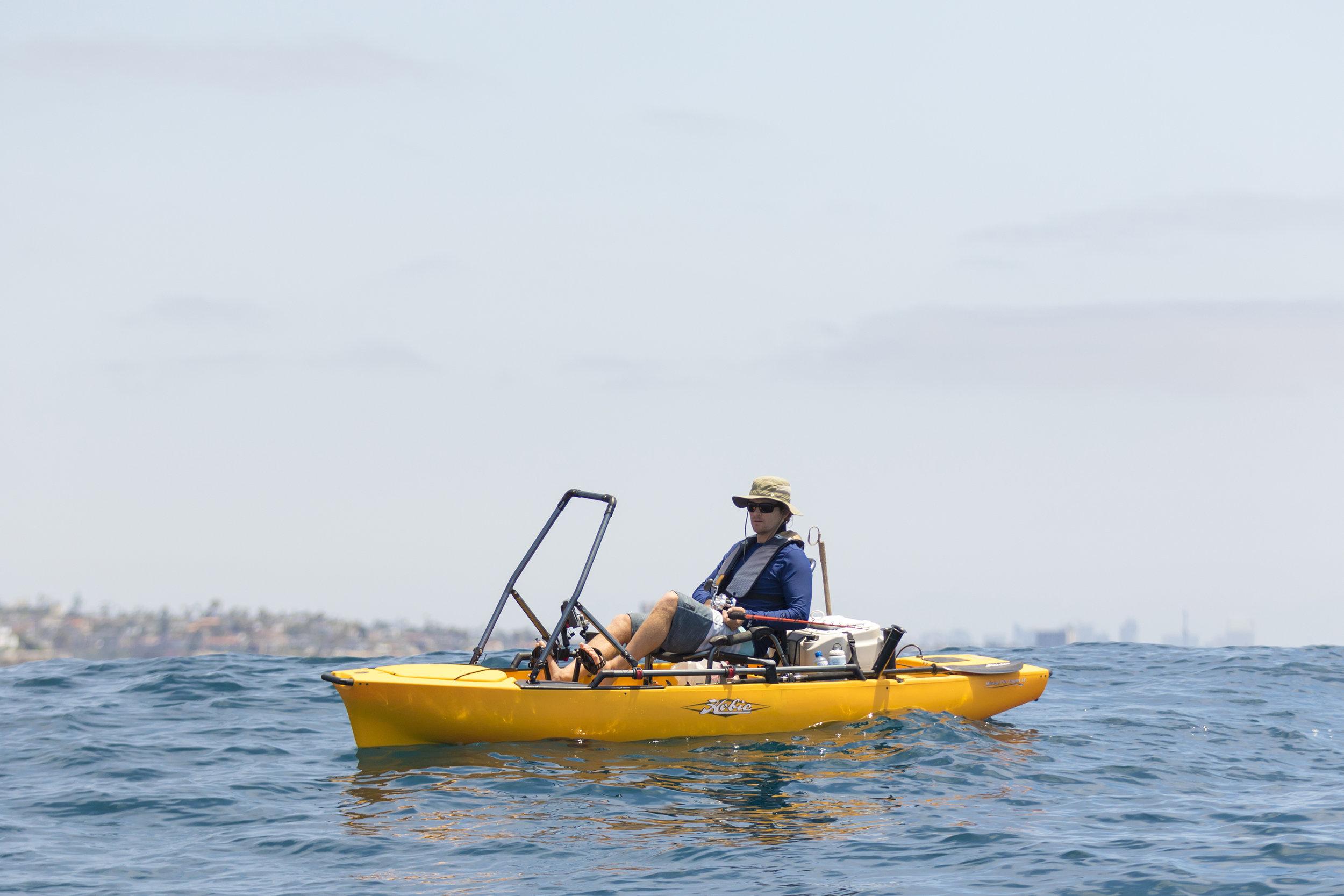 ProAngler12-action-fishing-hBar-Brendan-ocean-sitting-lg.jpg