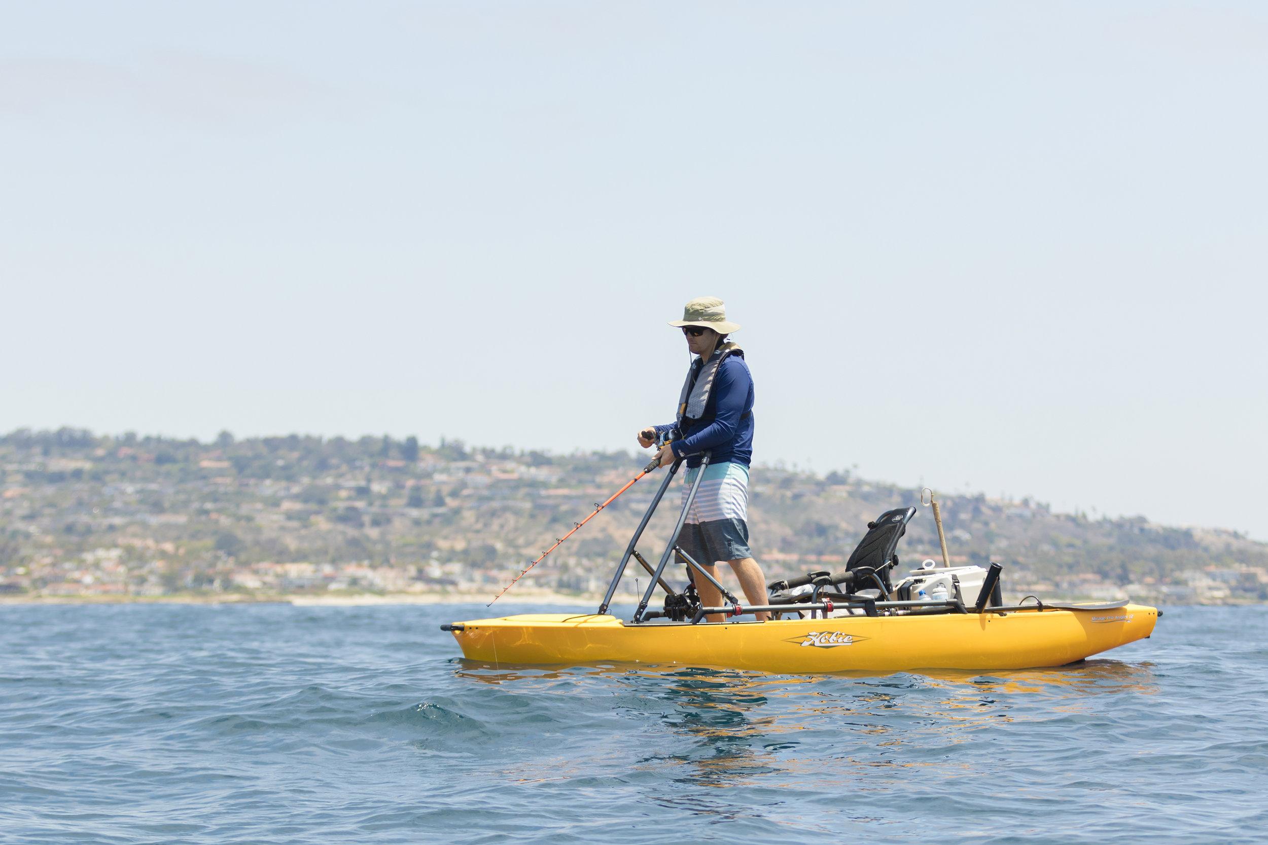 ProAngler12-action-fishing-hBar-Brendan-ocean-standing-lg.jpg