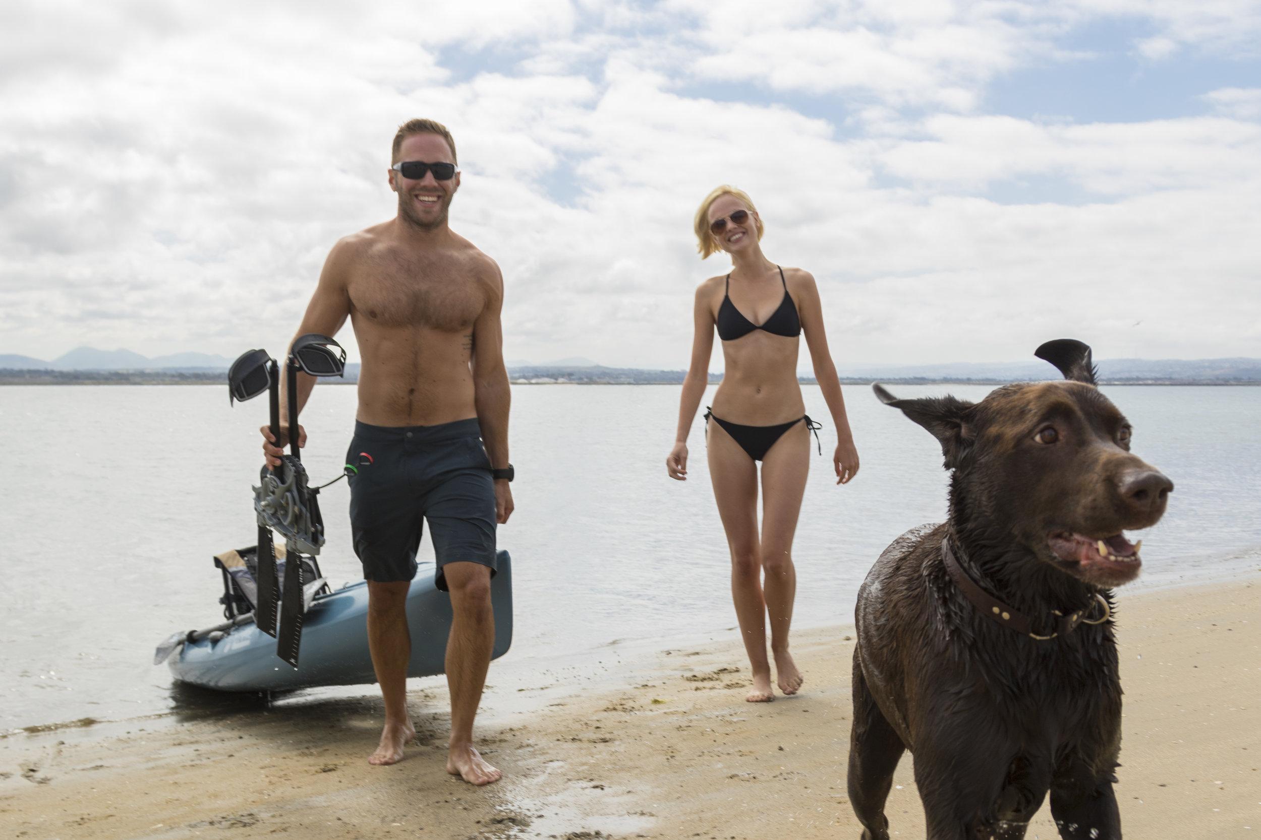 Revolution13_action_dog_couple_beach_carry.jpg