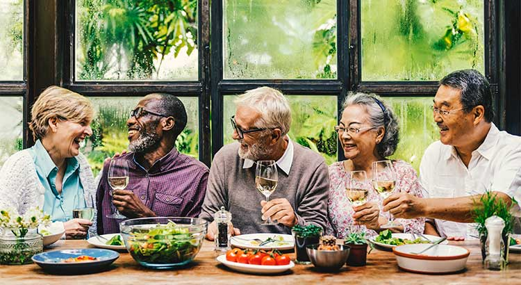 Old people eating together