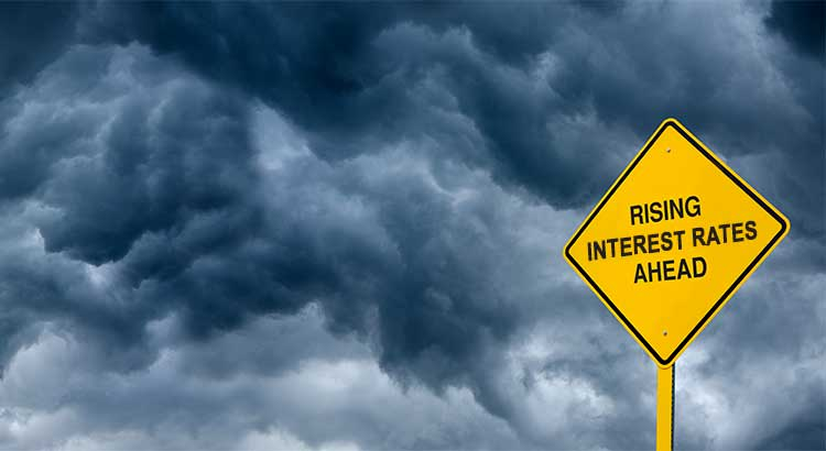 Dark clouds and a road sign