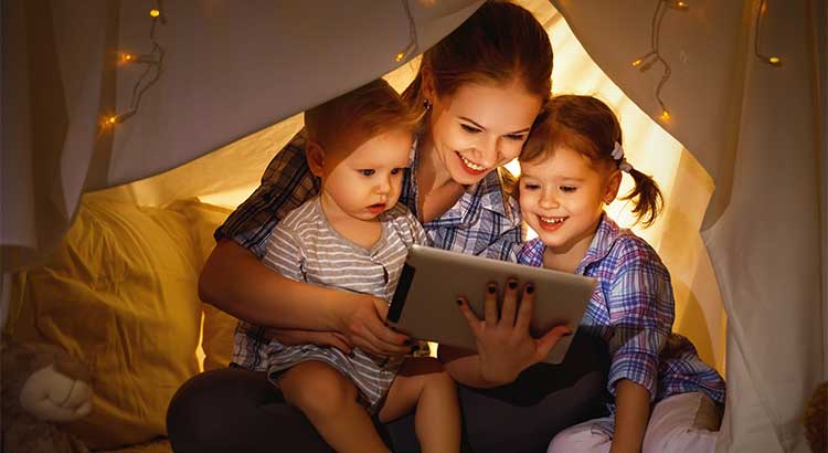 mother reading stories for her children
