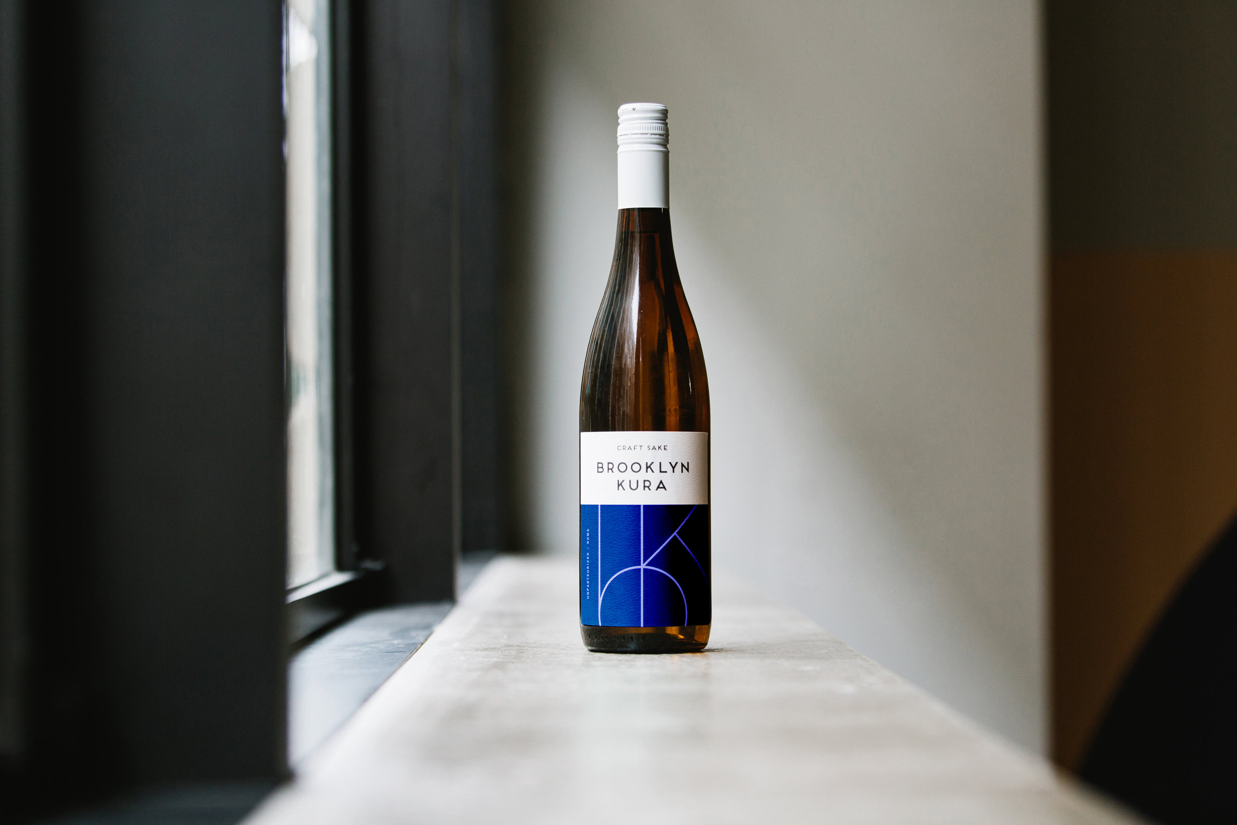BLUE DOOR Junmai - Full-bodied, earthy and dry. Umami laden with subtle notes of banana and melon