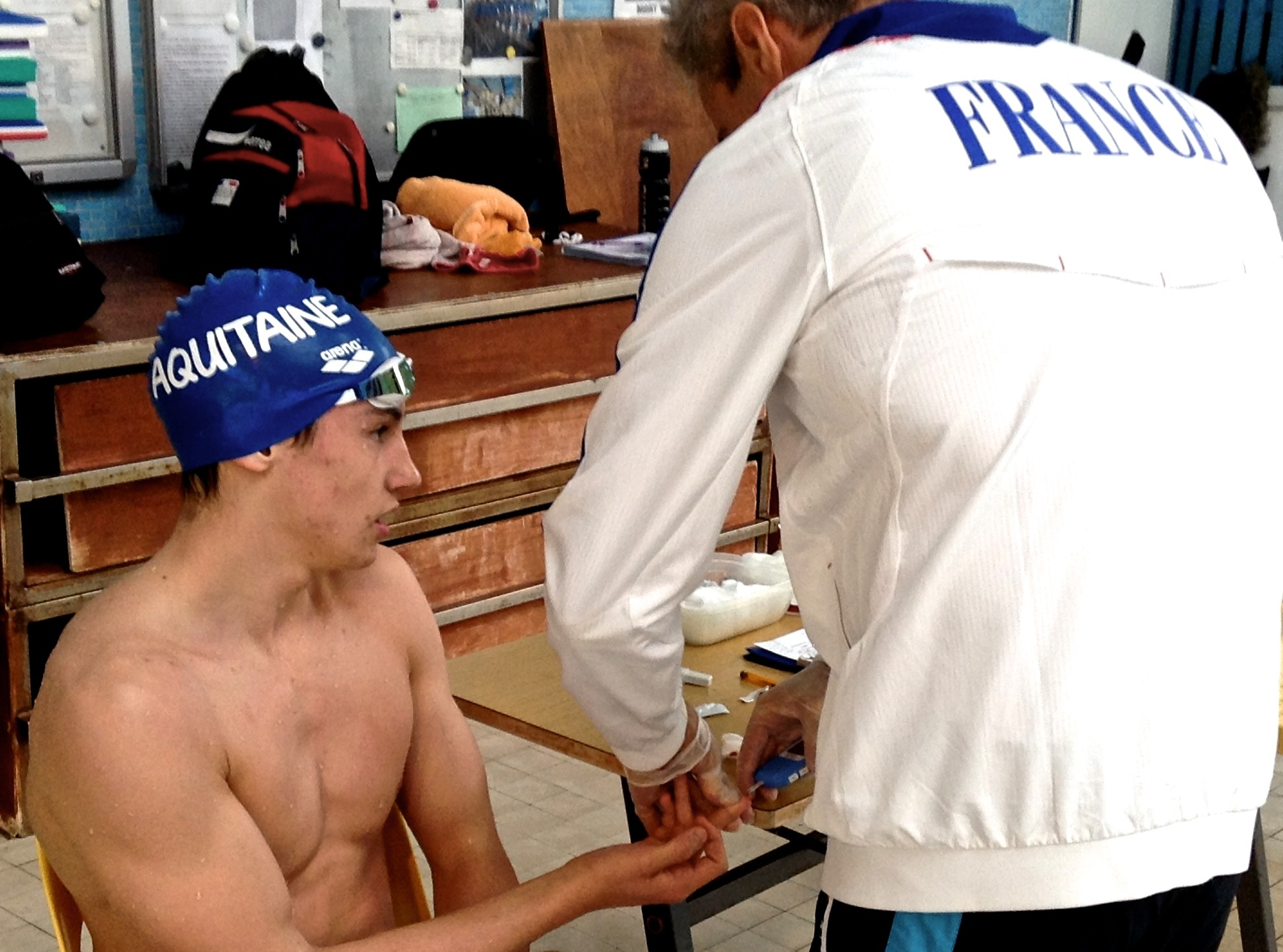 Fig 1: A French national team member gets his lactate sample taken after an exhaustive exercise to determine glycolytic energy contribution using INSCYD.