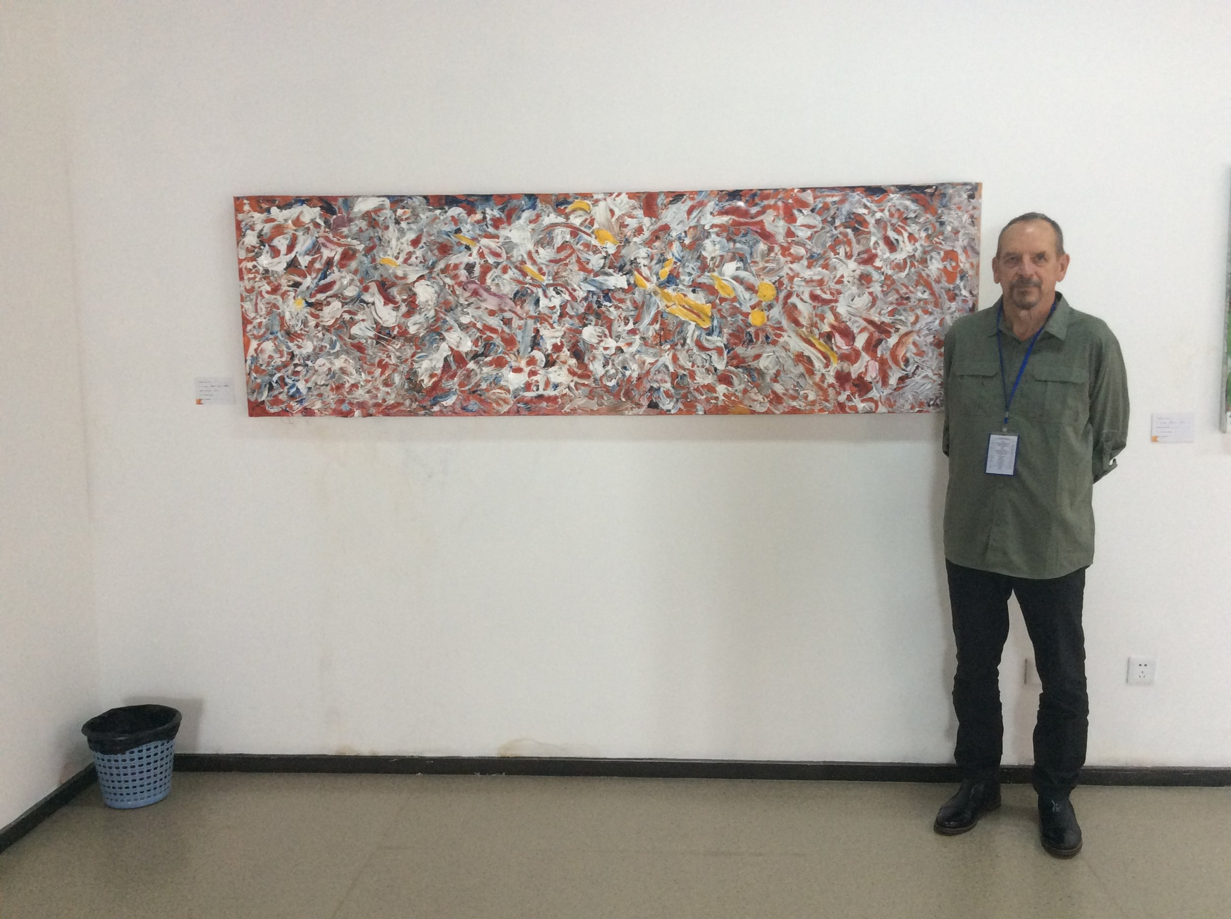Robert Scott with his artwork at the Xuancheng Exhibition