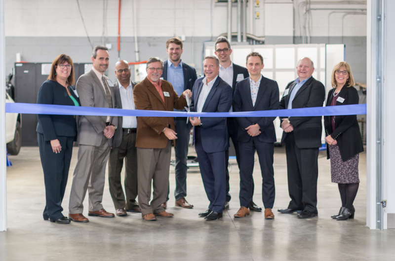 Ribbon Cutting Ceremony on November 8, 2017.   View Photo Gallery     On the photo:  Hope Mascott, Director of Marketing, Altran NA; Steve Brown, City Manager of Wixom, Wixom, MI; Mohan Raju, Head of Automotive, Altran Engineering Solutions; Kevin Hinkley, Mayor, Wixom, MI (cutting the ribbon); Rob Vatter, CEO, Altran NA (cutting the ribbon); Keith Williams, CTO, Altran; Dave Martin, VP Programs, Passive Safety, Altran NA; Debra Barker, Economic & Community Development Director, Wixom, MI;   Backrow: Sebastian Wipfler, Passive Safety Operations Manager, Altran; Ferdinand Schwinger, Global Passive Safety Operations Director, Altran