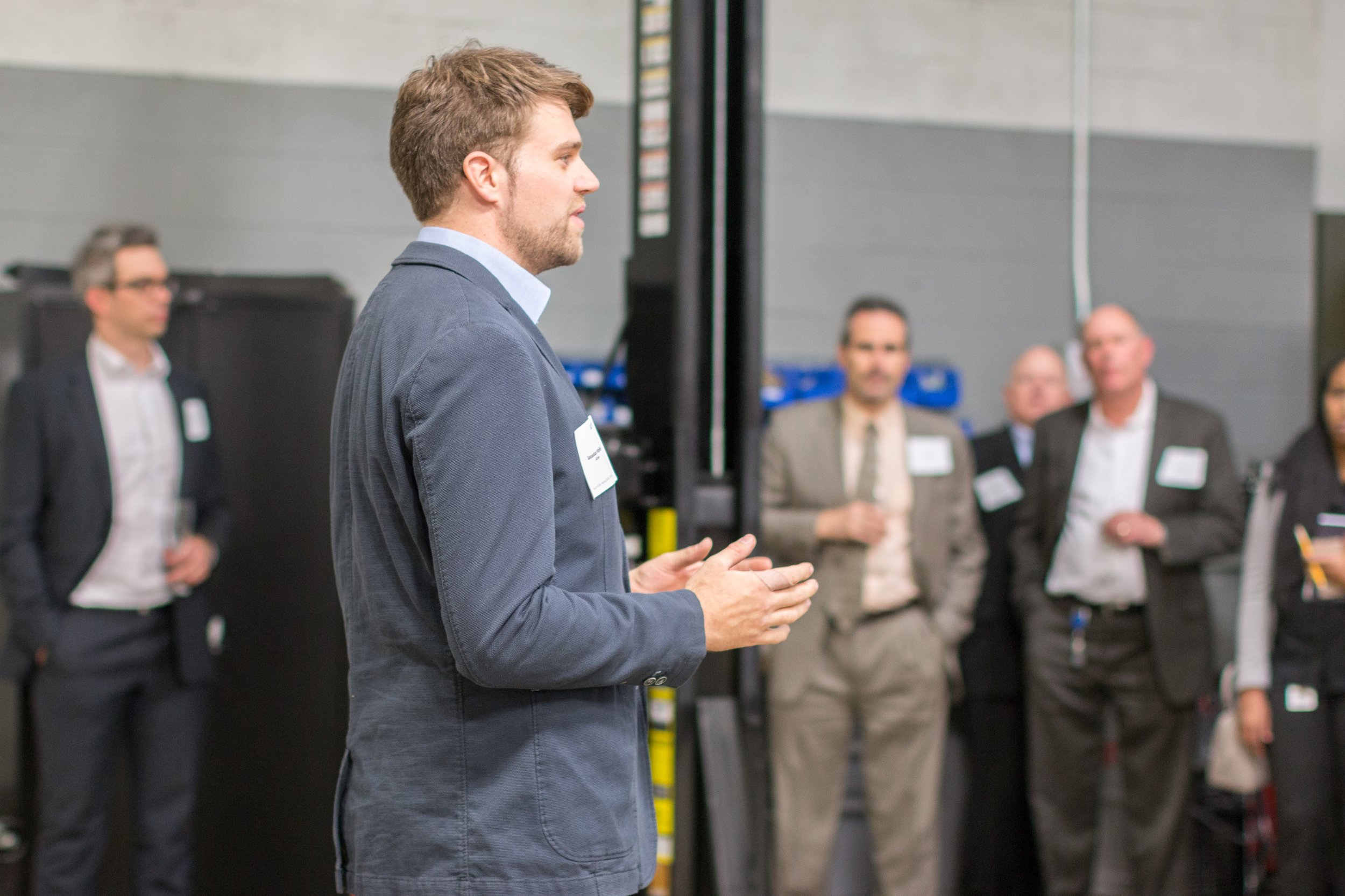 Sebastian Wipfler conducting a tour of the Passive Safety Center