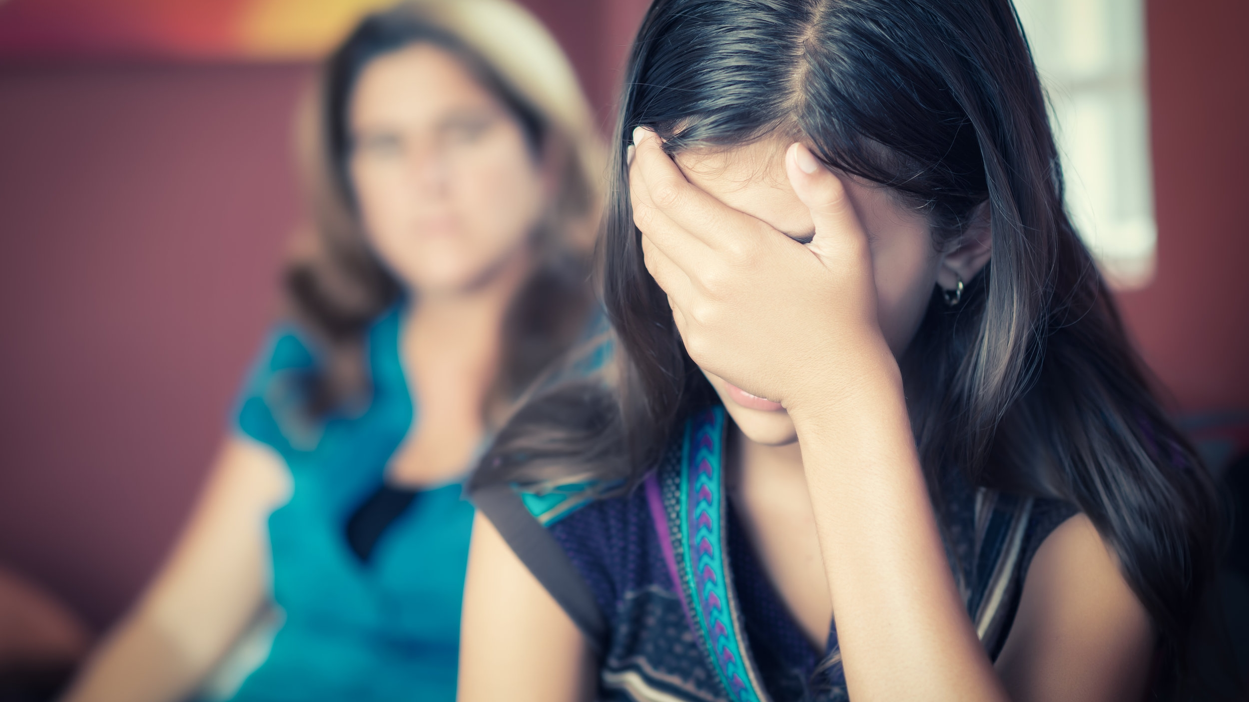 11_ShSt_stock-photo-teenager-problems-teenage-girl-cries-while-her-mother-looks-at-her-on-the-background-210886186.jpg
