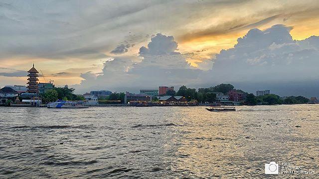 Sunset over the Chao Phraya River in Bangkok, Thailand with the Mazu shrine to the left #Bangkok #sunset #alltheshots . . . #river #landscape #water #light #boat #shrine #clouds #mazushtine #bangkok #thailand #travel #travelphotography #ericrayburnphotography  @lonelyplanet @bangkok.explore @thailandinsider