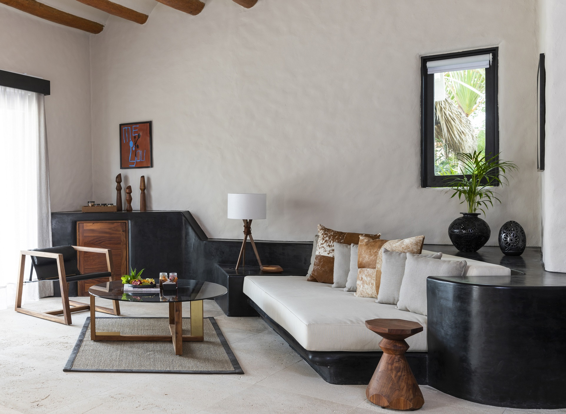 Thompson Zihuatanejo_Guest Room_Suite Seating Area.jpg