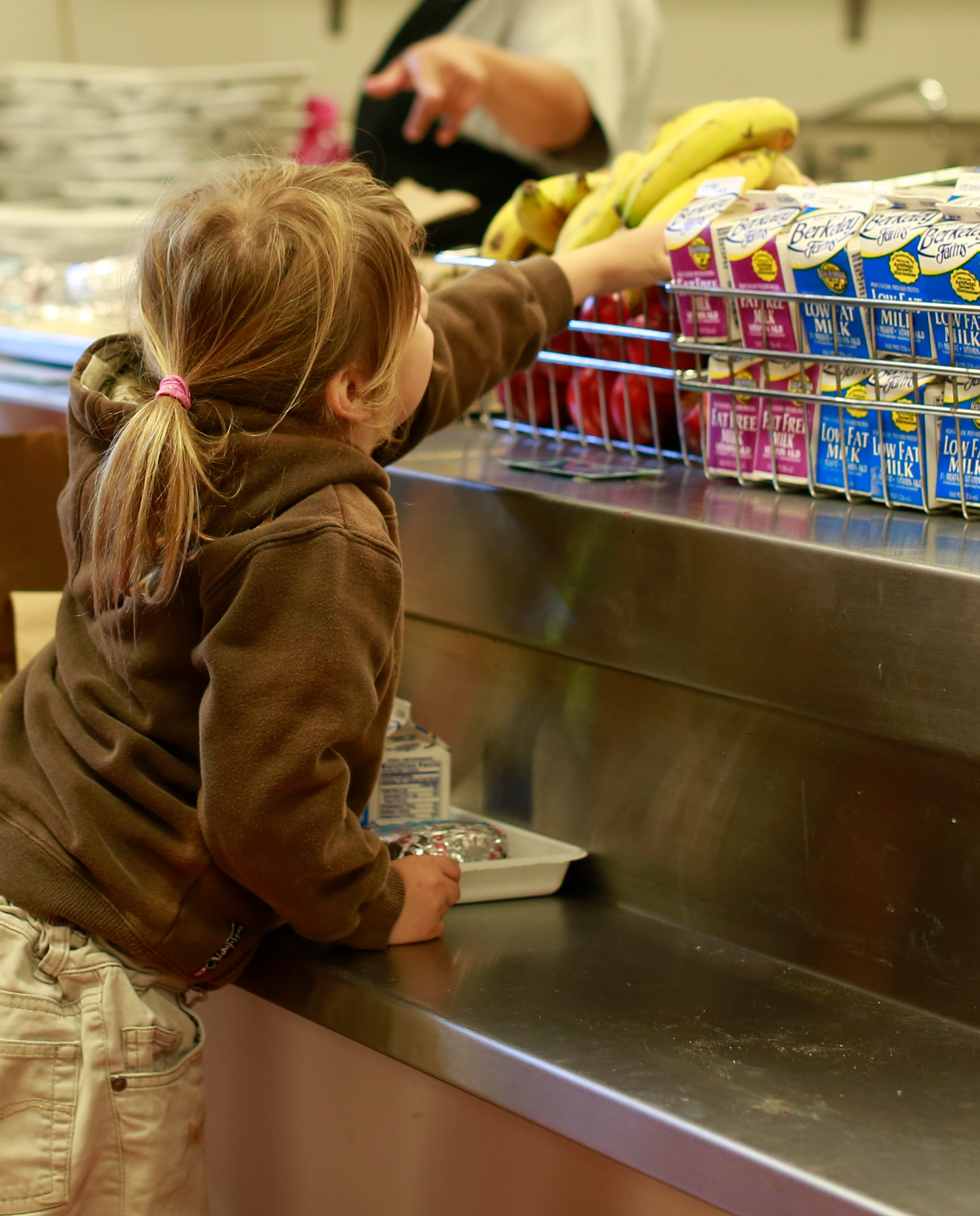Student Reaching for Fruit in line (1).png