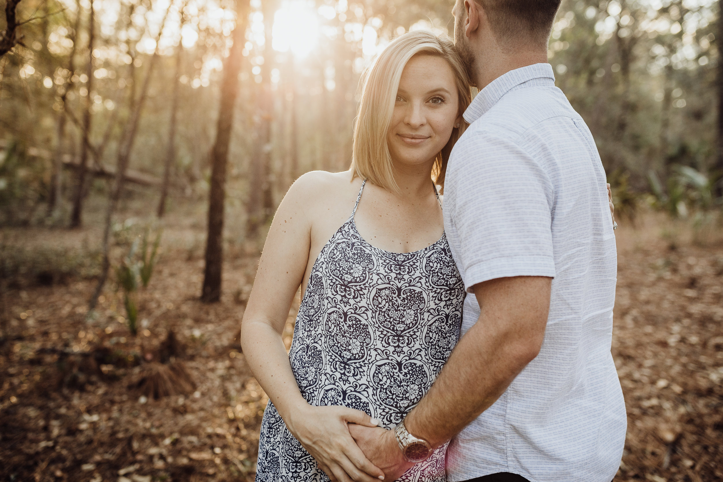 Orlando Maternity Photographer with session location at Kelly Spring park with a boho maxi dress