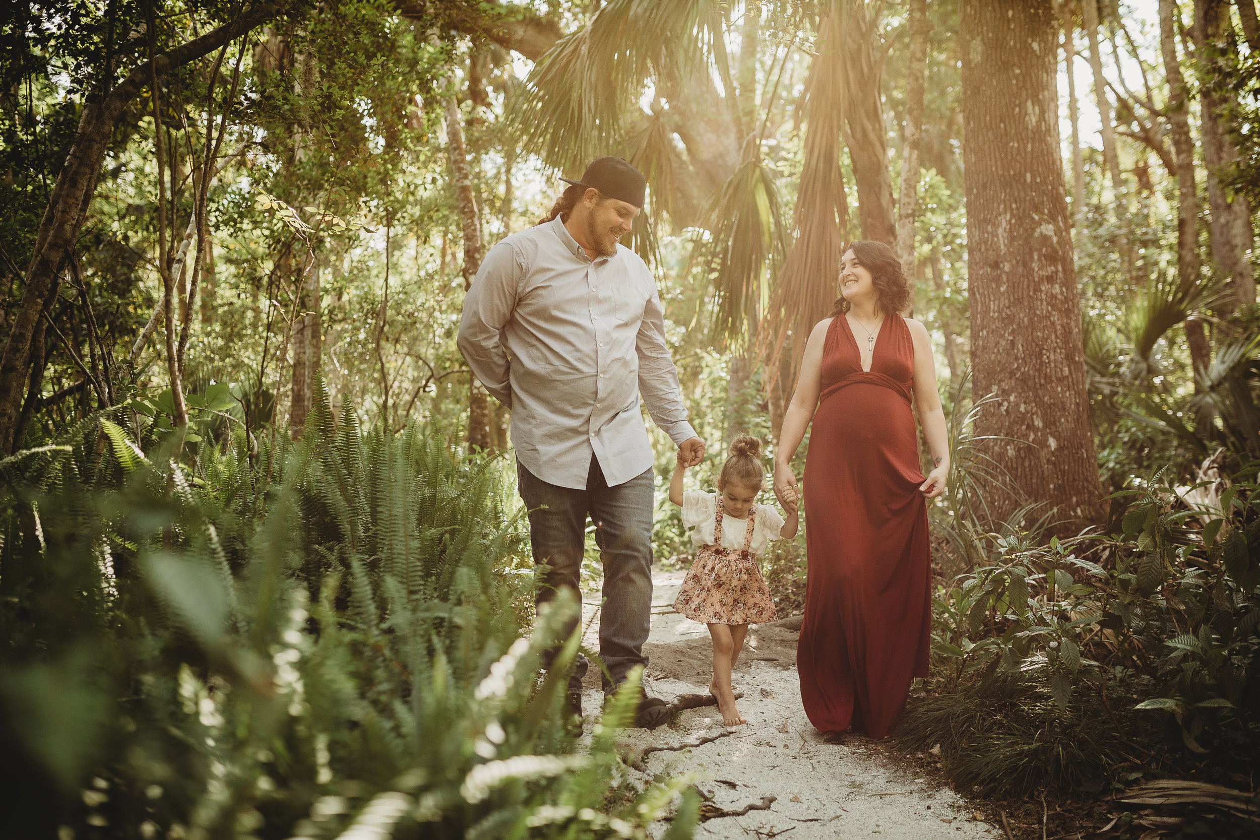 Daytona Beach Maternity photographer capturing emotive images at Sugar Mill Gardens in Port Orange