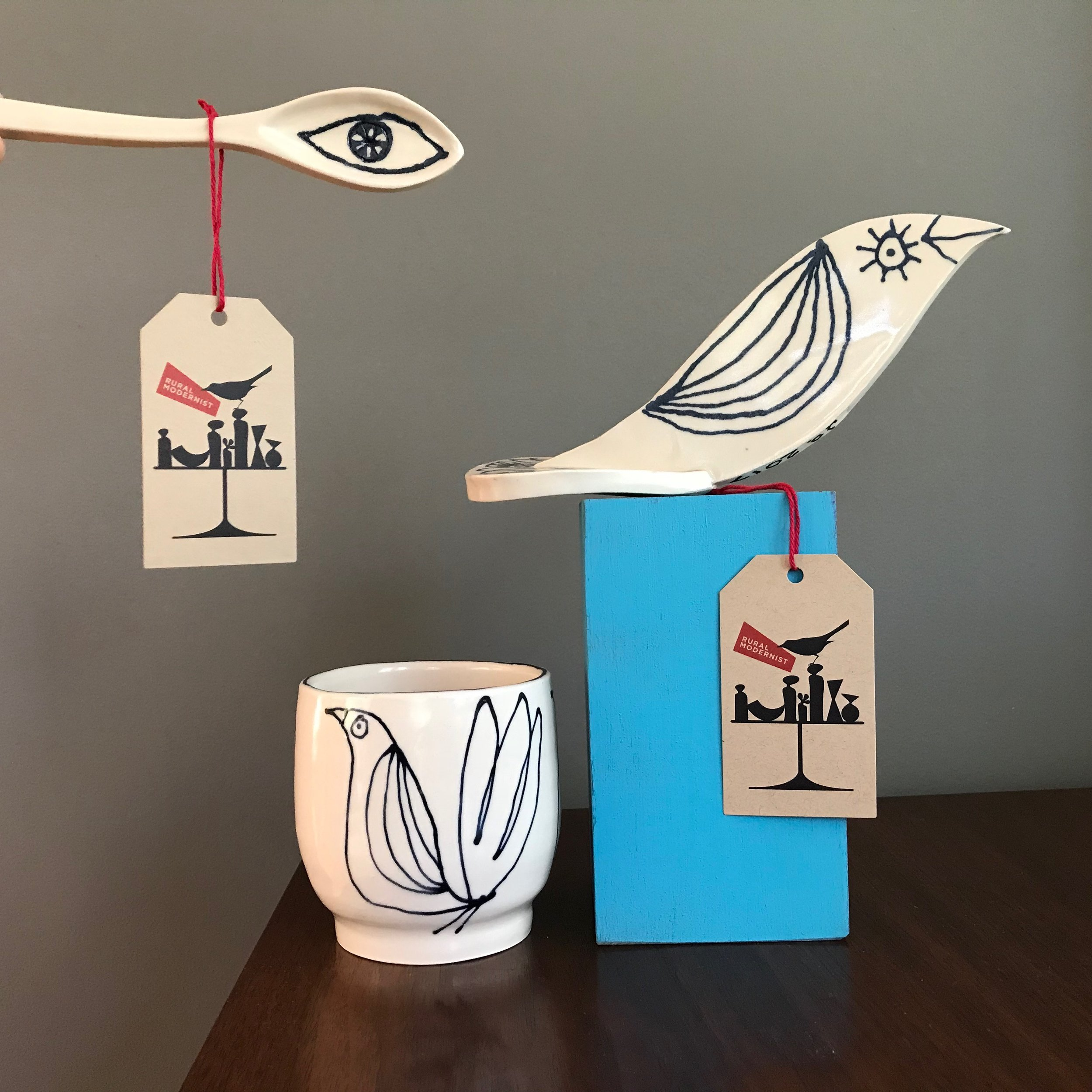 blotted line - Birds, eyes, and stripes loosely doodled on handmade ceramics.
