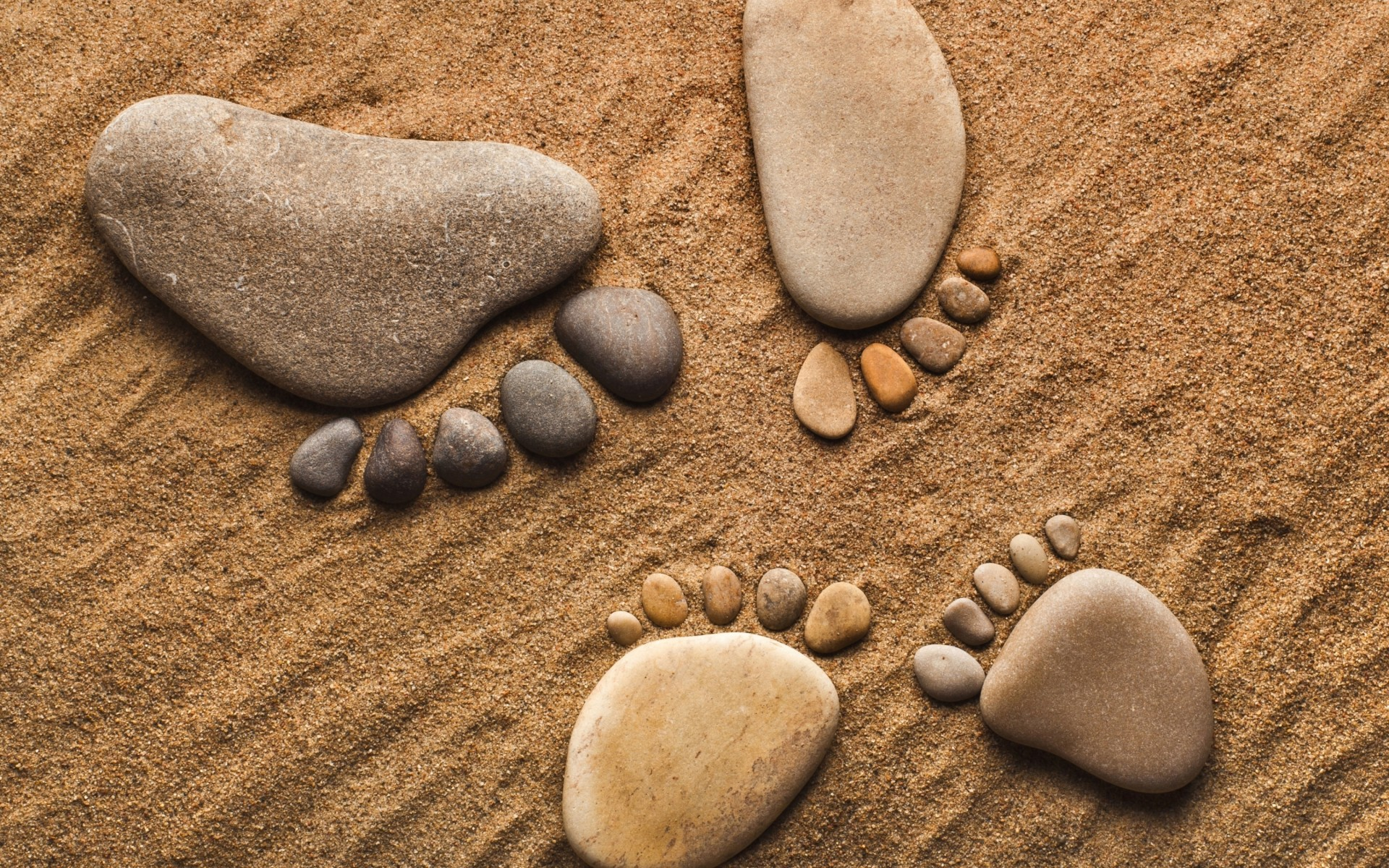 Feet rocks on sand.jpg