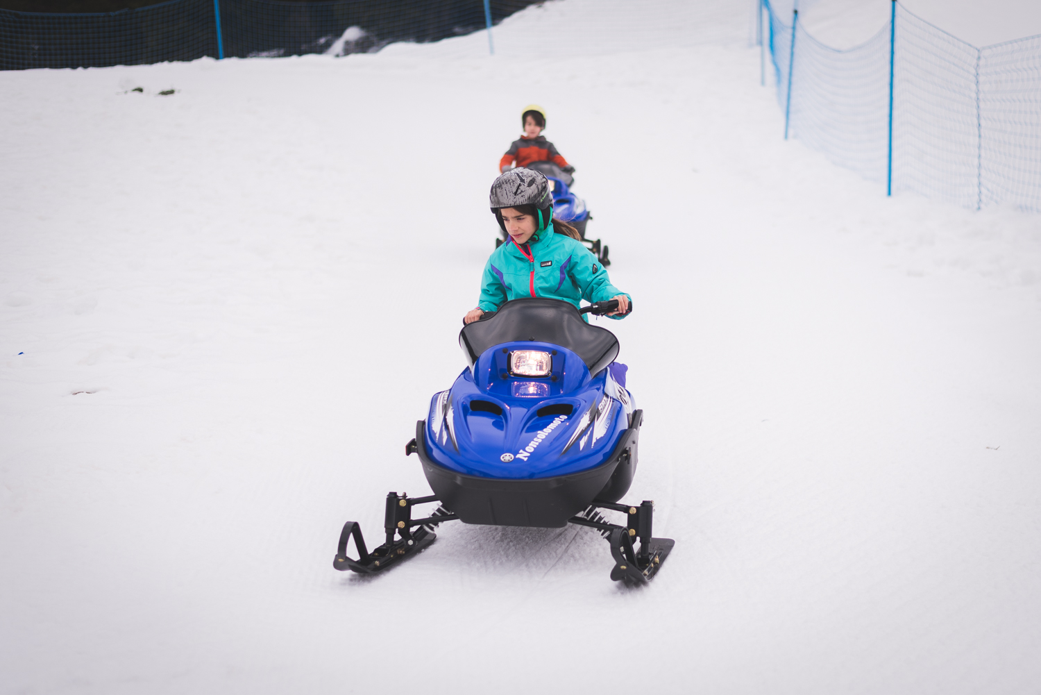 The oldest two, Piper (8) and Aidan (9) got to take out their own snowmobile this year!