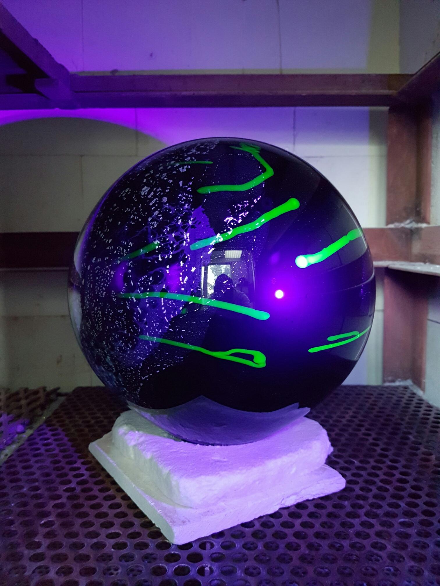 35_Gillian McFarland, Uv lit Space Globe in kiln, including Uranium Glass.jpg