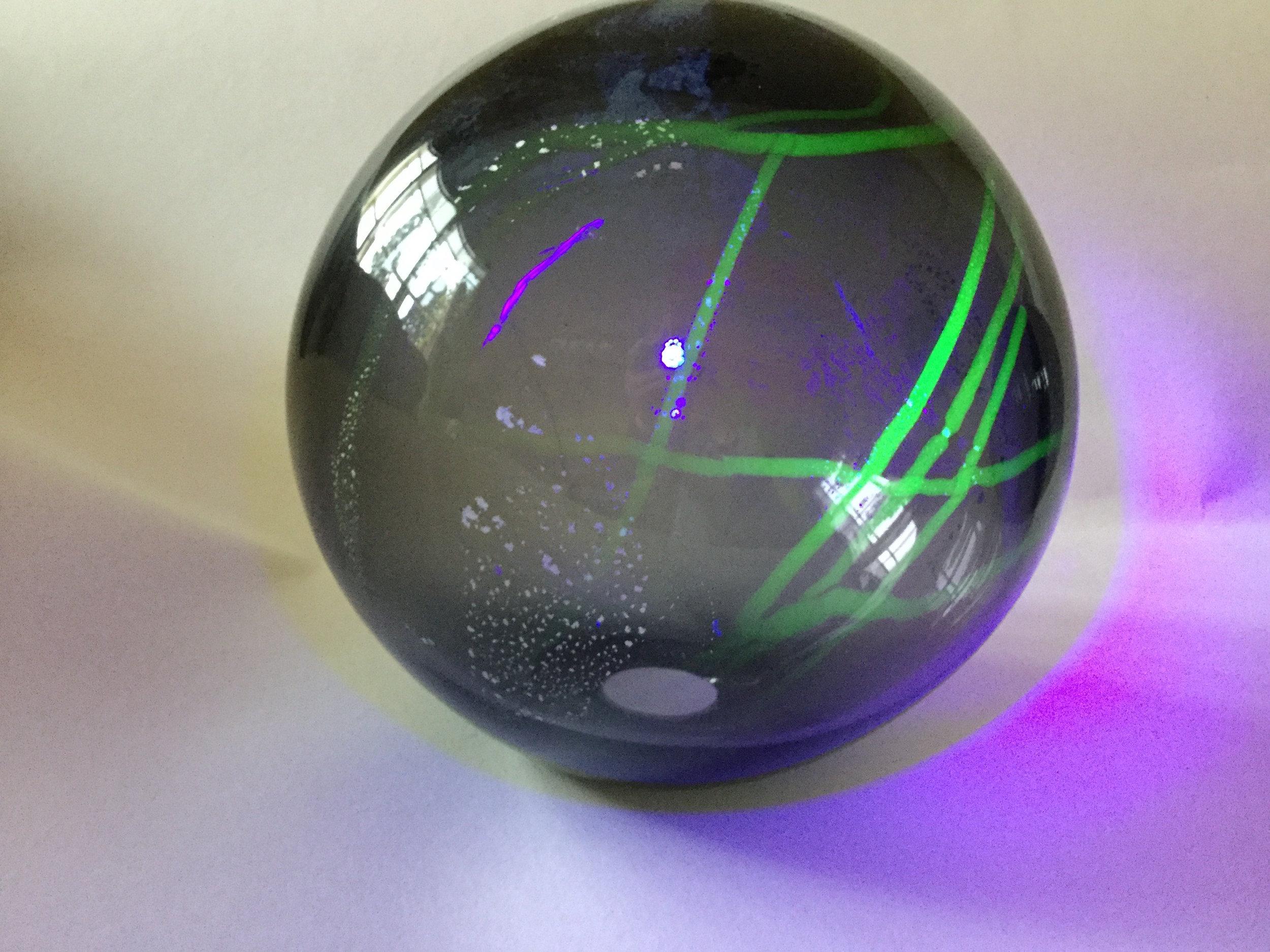 50b_Gillian McFarland, Glass globe with Uranium glass & UV light 2.JPG