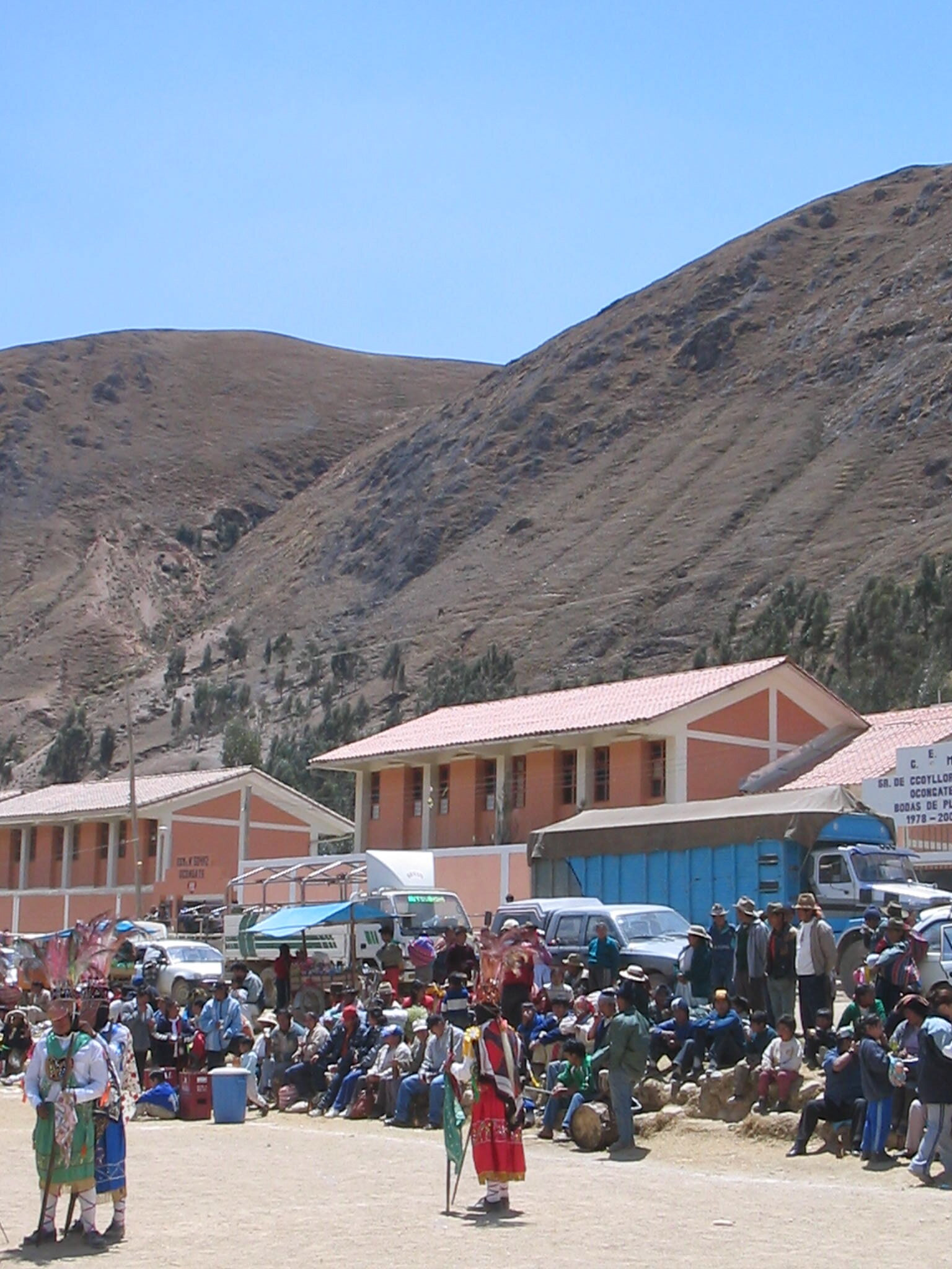 In the high Andean town of Ocongate, a dance troop of Qhapaq Ch'uncho prepares to board their truck to the Qoyllorit'i trail head further up the road. (September, 2003.)