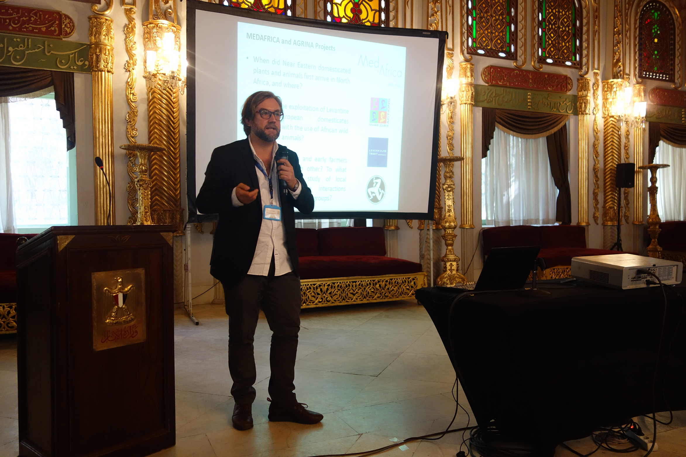 Giulio Lucarini giving his talk 'Out of the orphanage: Shedding new light on the ground stone tools from North African contexts through functional analysis' (photo: Claire Malleson)