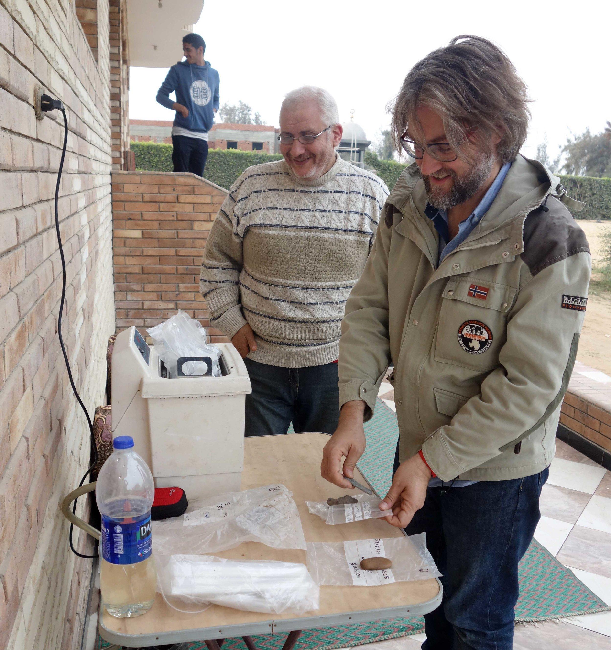 Merimde Beni Salama. Giulio Lucarini cleaning the stone tools in the ultrasonic tank (photo: Joanne Rowland; © Egypt Exploration Society)