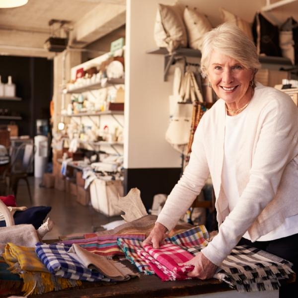 Woman in her shop, organising her homewares product.