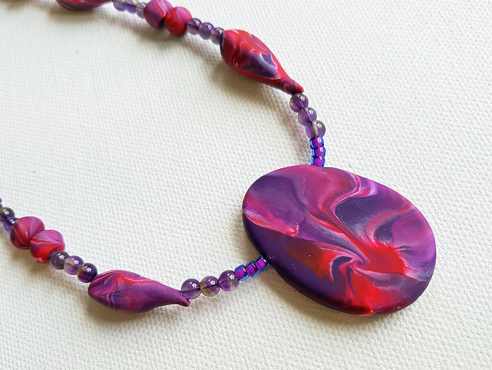 Mitch's pendant necklace in red and purple