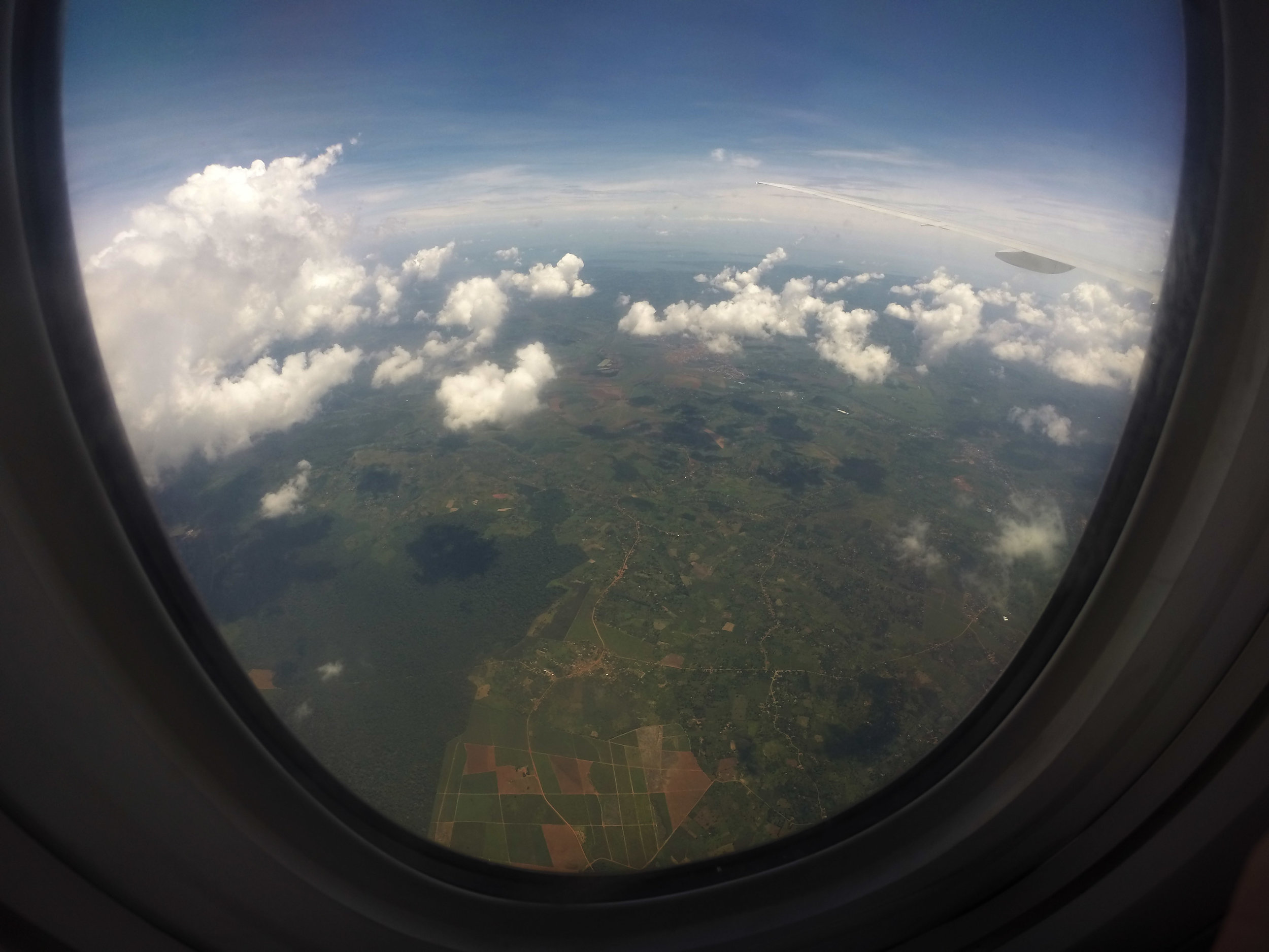 Descent into Kampala looking out on the terrain and clouds of Uganda.