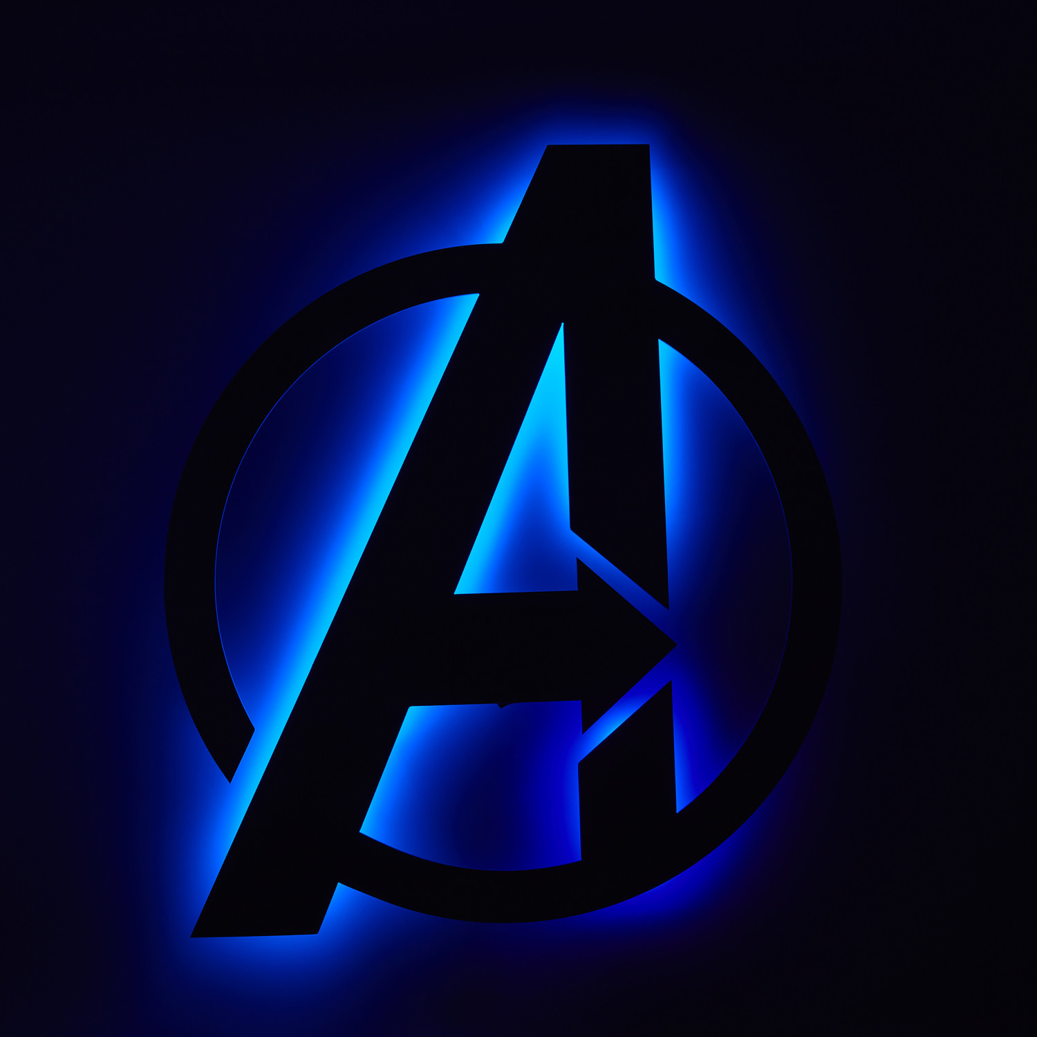 I already used a picture of Thanos in the end credits scene, so here's a backlit Avengers logo instead.