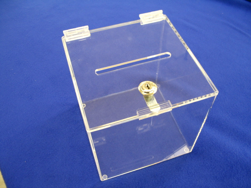"""Donation/Ballot Box with Lock   Item #  DB-8080  Price:  $48.75 each  Dimensions:  8.00"""" x 8.00"""" x 8.00"""" Dim. O.D. A popular unit for trade shows, drawings, fund raisers, auctions. Can be fabricated in many different sizes and colors. Header card attachments for additional graphics are also an option. Unit shown is 3/16"""" clear acrylic, comes with 2 keys."""