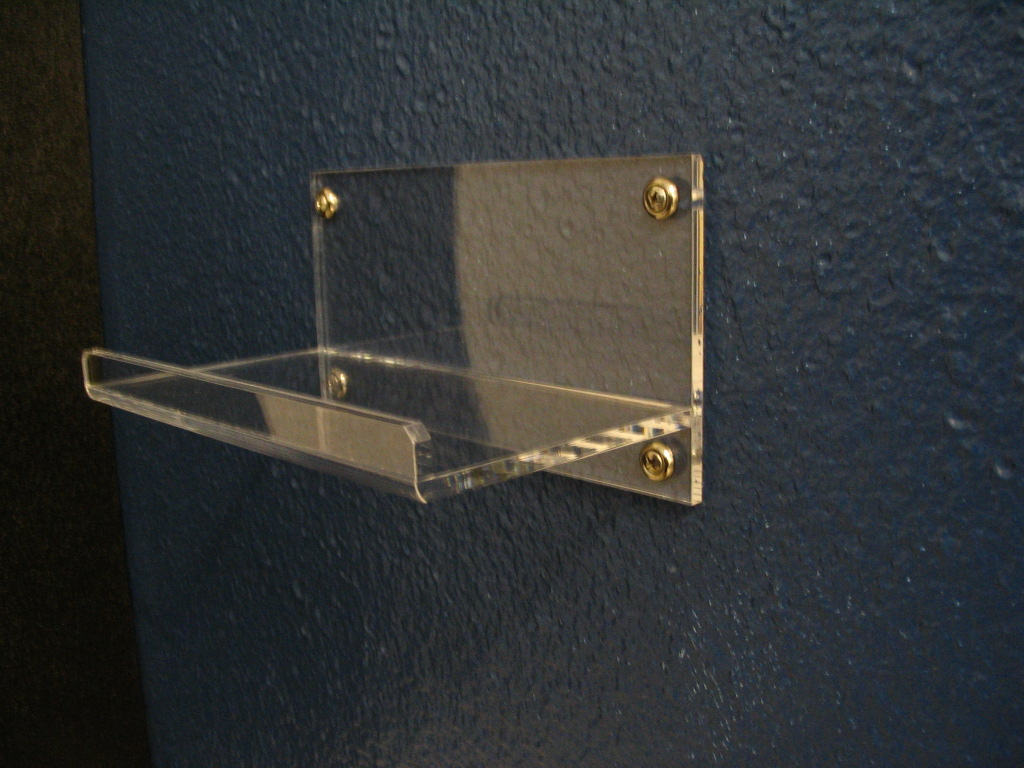 """8"""" Wall Mounted Shelf   Item #  WMS-8040  Price:  $13.50 each  Dimensions: 8.00"""" W x 4.50"""" D x 4.25"""" H Dim. O.D. Display or organize personal items with this high quality shelf. Constructed from 1/4"""" clear acrylic. Machined and polished edges. Many custom sizes available."""