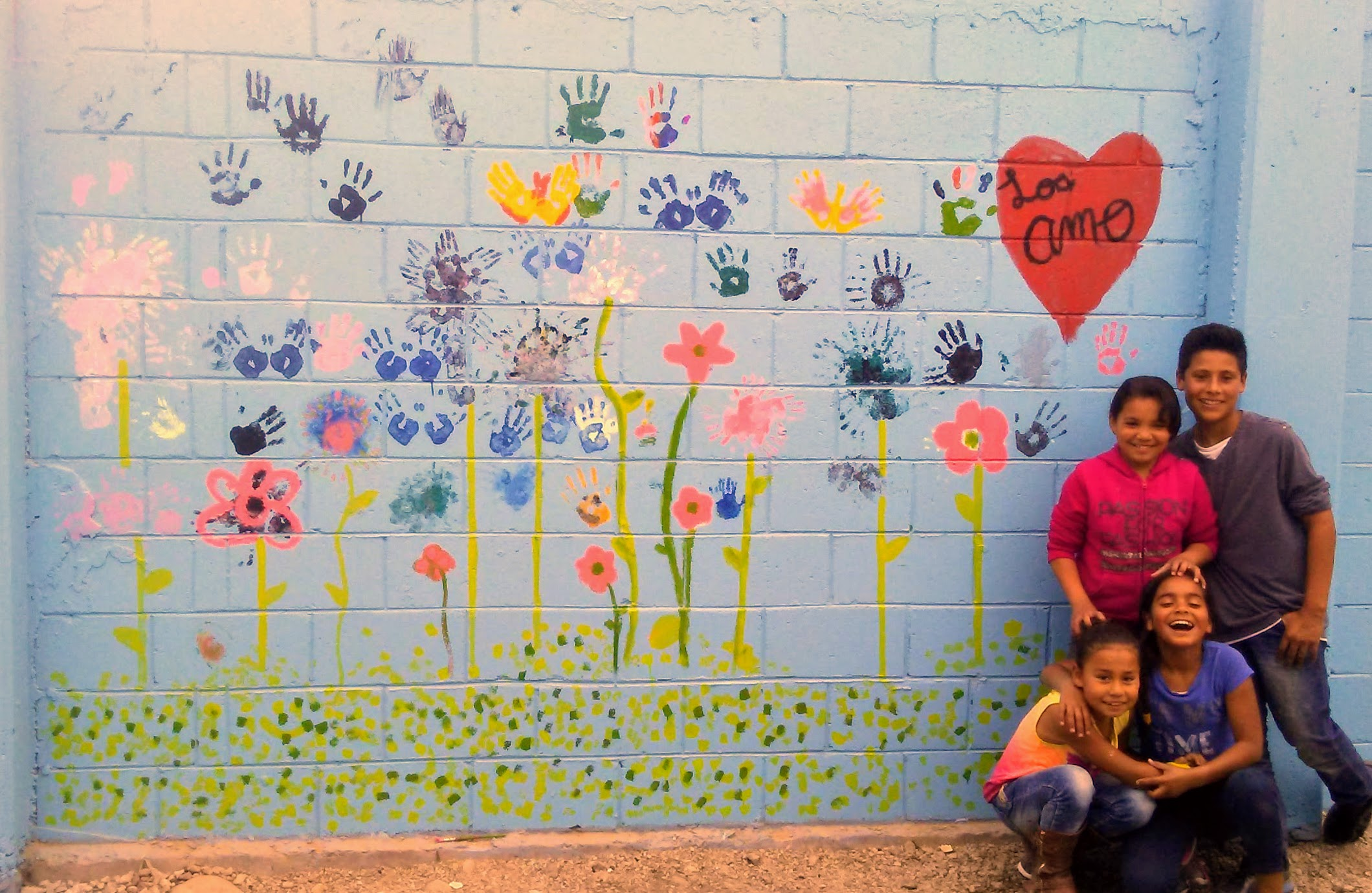 Hand painted the wall with the kids hands, heart, and joy!