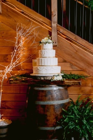 Venue:  Barn at Glistening Pond , Cake:  Minooka Pastry , Photographer:  Danielle Coons